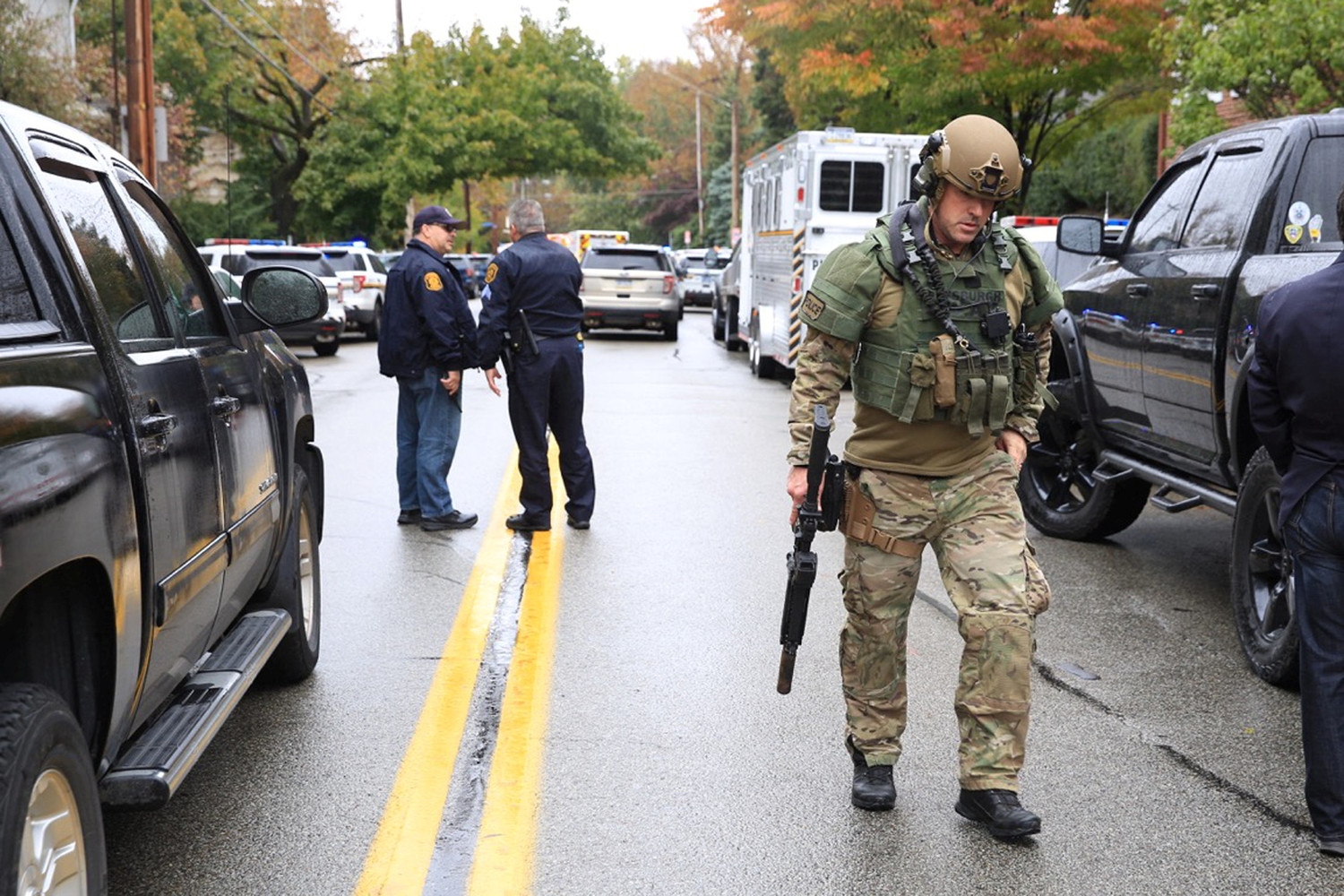 A SWAT police officer and other first responders are seen Oct. 27 after a gunman killed at least four people at the Tree of Life Synagogue in Pittsburgh. Robert Bowers opened fire that morning during a service at the synagogue, also wounding at least six others, including four police officers, authorities said.