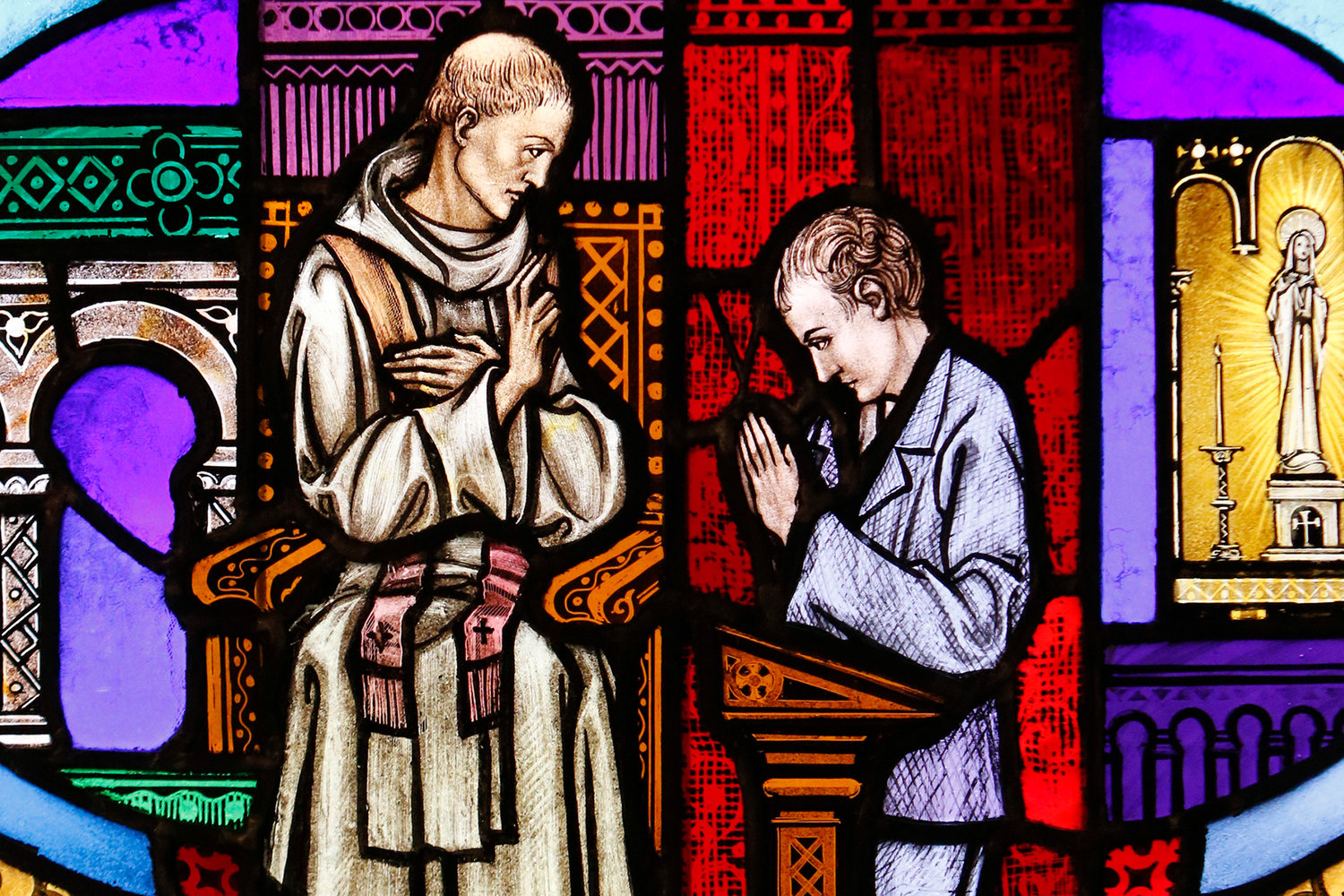 The sacrament of reconciliation is depicted in a stained-glass window at St. Aloysius Church in Great Neck, N.Y.