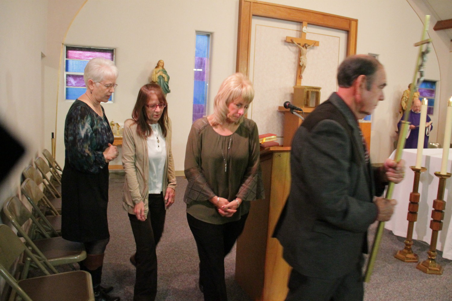 Members of the St. Martha pastoral council in Wayland process out of St. Martha Church at the end of Mass on Dec. 9.