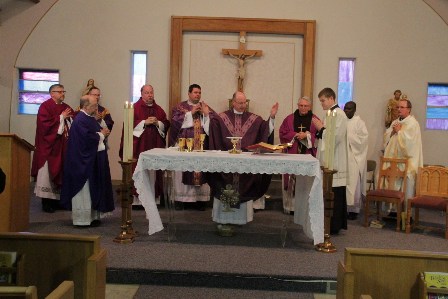Bishop McKnight and concelebrating priests pray the Eucharistic Prayer.