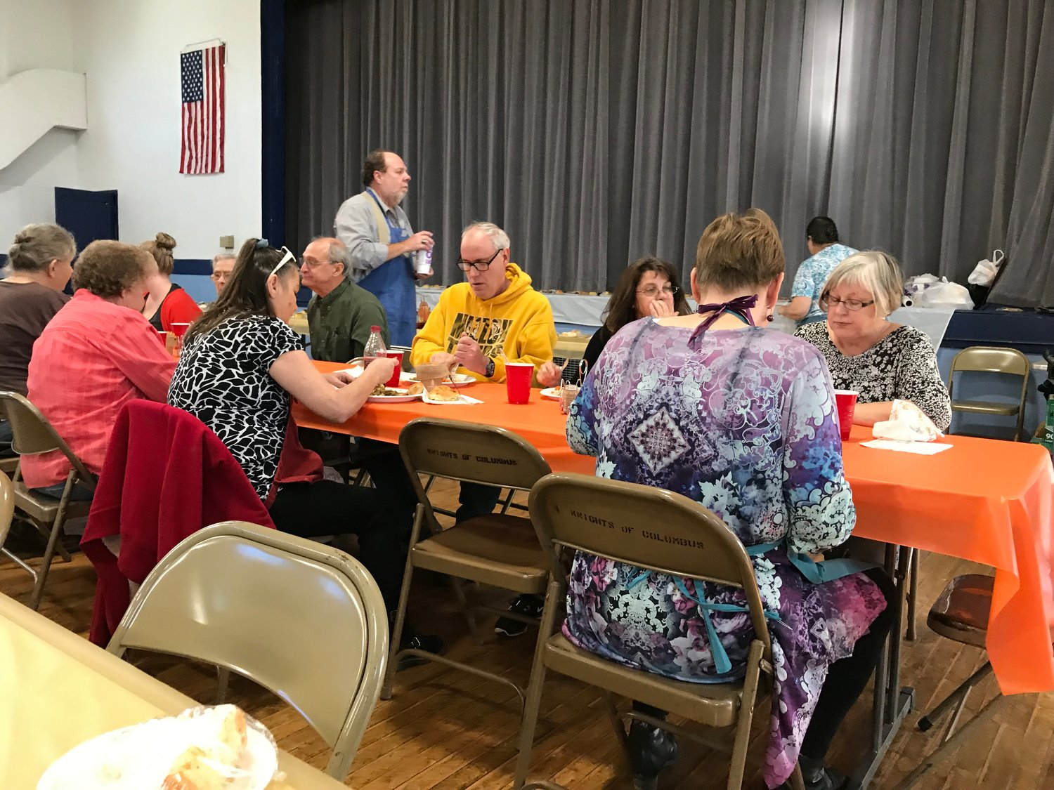 "People from in and around Montgomery City enjoy a community Thanksgiving Day meal prepared by members of the Steffan family in honor of the late Orville ""Buzz"" Steffan, who was very active in Immaculate Conception parish, the Knights of Columbus and many community events and organizations."