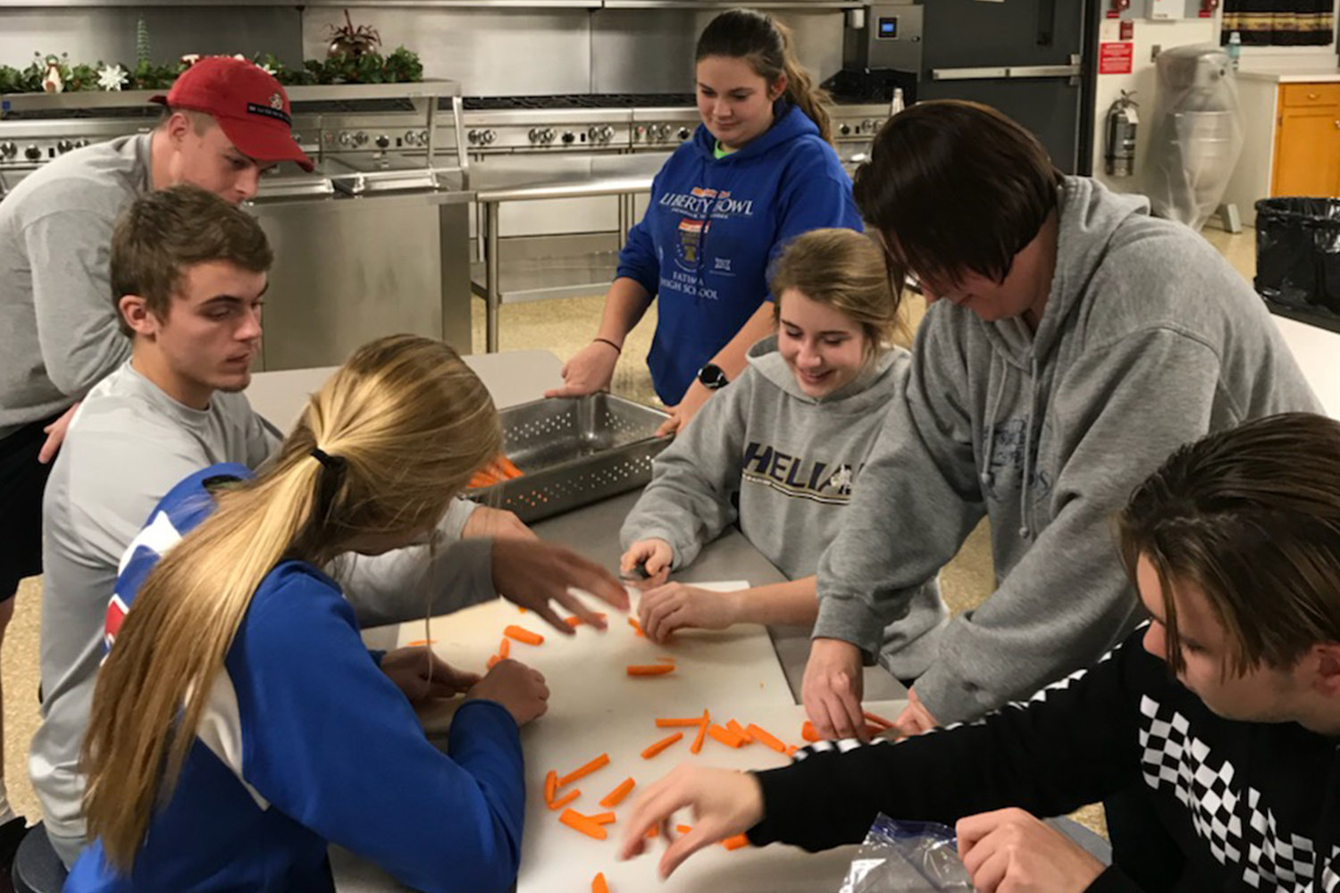Confirmation candidates from St. Stanislaus parish in Wardsville prepare, serve and clean-up after dinner at the Salvation Army's Center of Hope in Jefferson City.