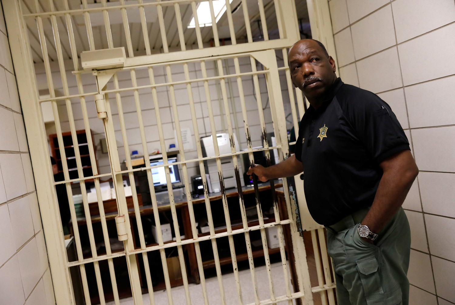Warden Dennis Grimes opens the doors to holding cells in the East Baton Rouge Parish Prison in Baton Rouge, Louisiana, last March. The federal government could start shaving the size of its prison populations now that the First Step Act become has become law.