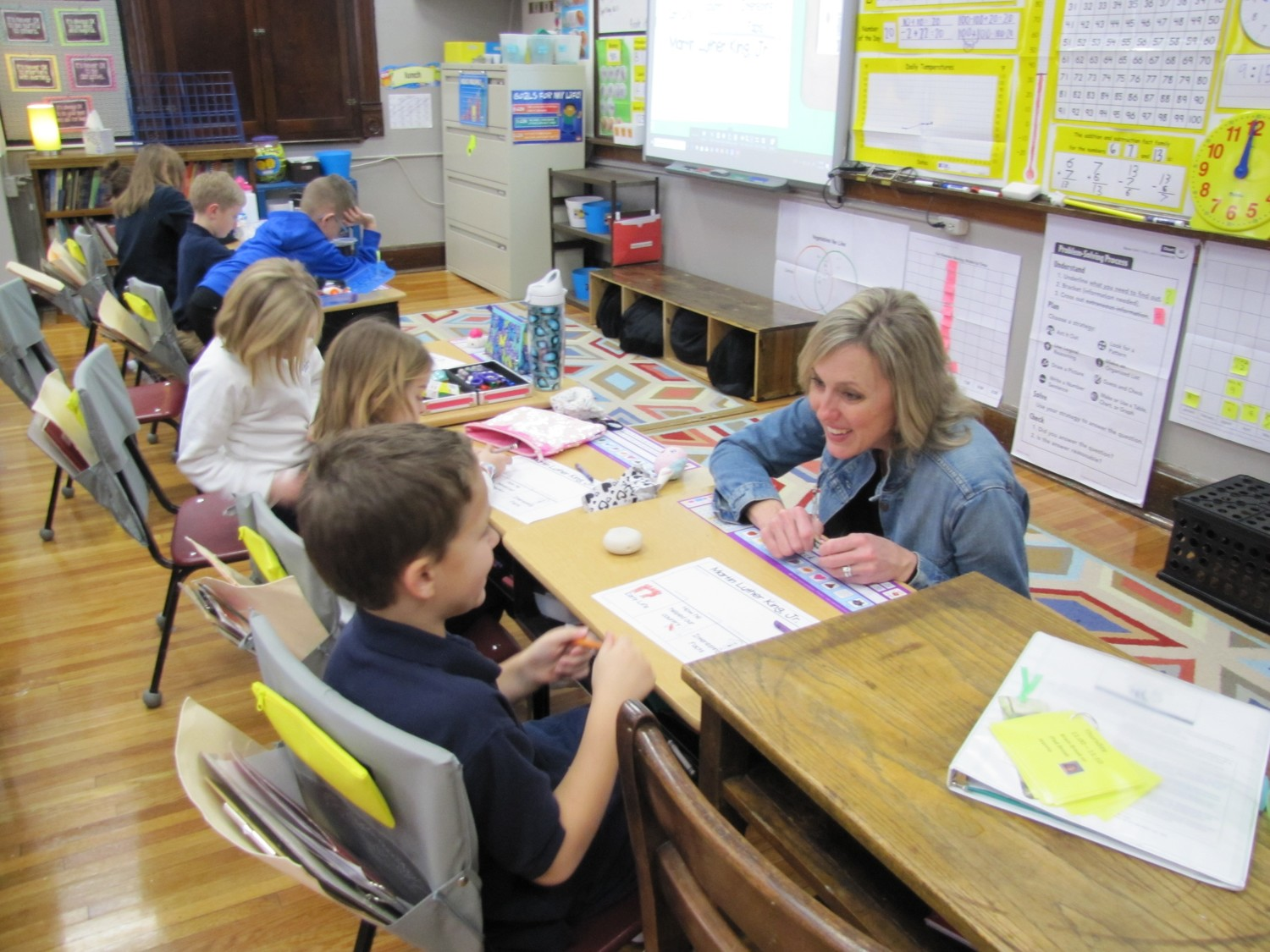 "Lesha Neidert interacts with one of her second grade students at St. Peter Interparish School in Jefferson City. Mrs. Neidert has been selected to receive a ""Lead. Learn. Proclaim."" Award from the National Catholic Education Association, for excellence in distinguished service in Catholic education."