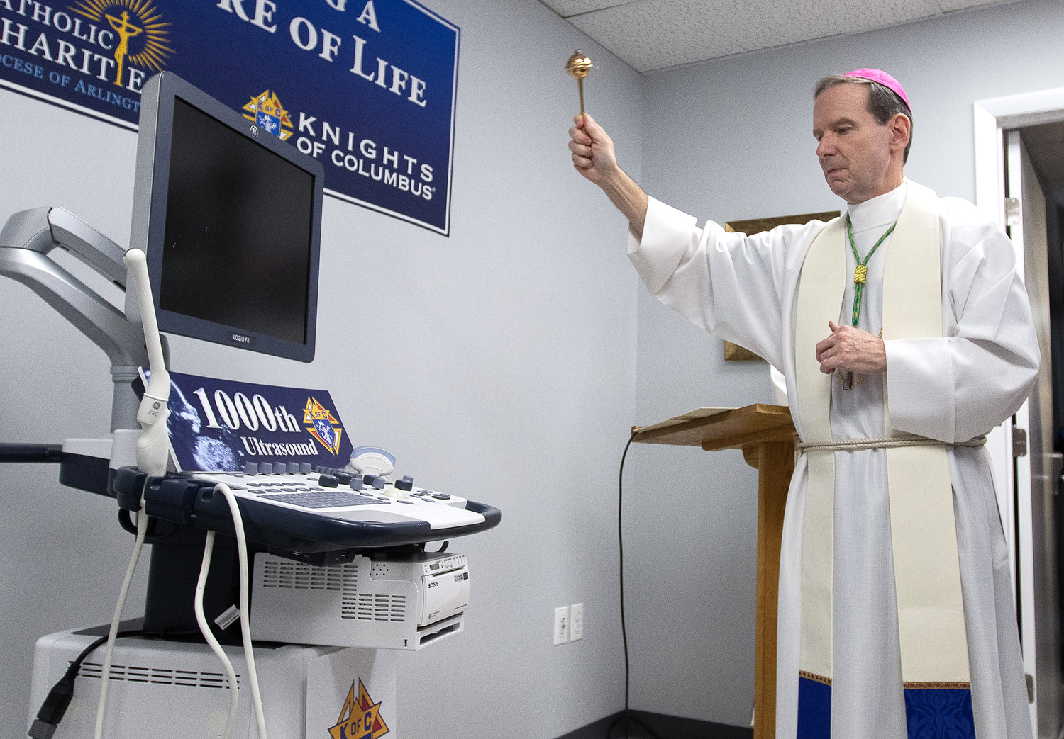 Bishop Michael F. Burbidge of Arlington, Va., blesses the new ultrasound machine for the Mother of Mercy Free Clinic in Manassas, Virginia