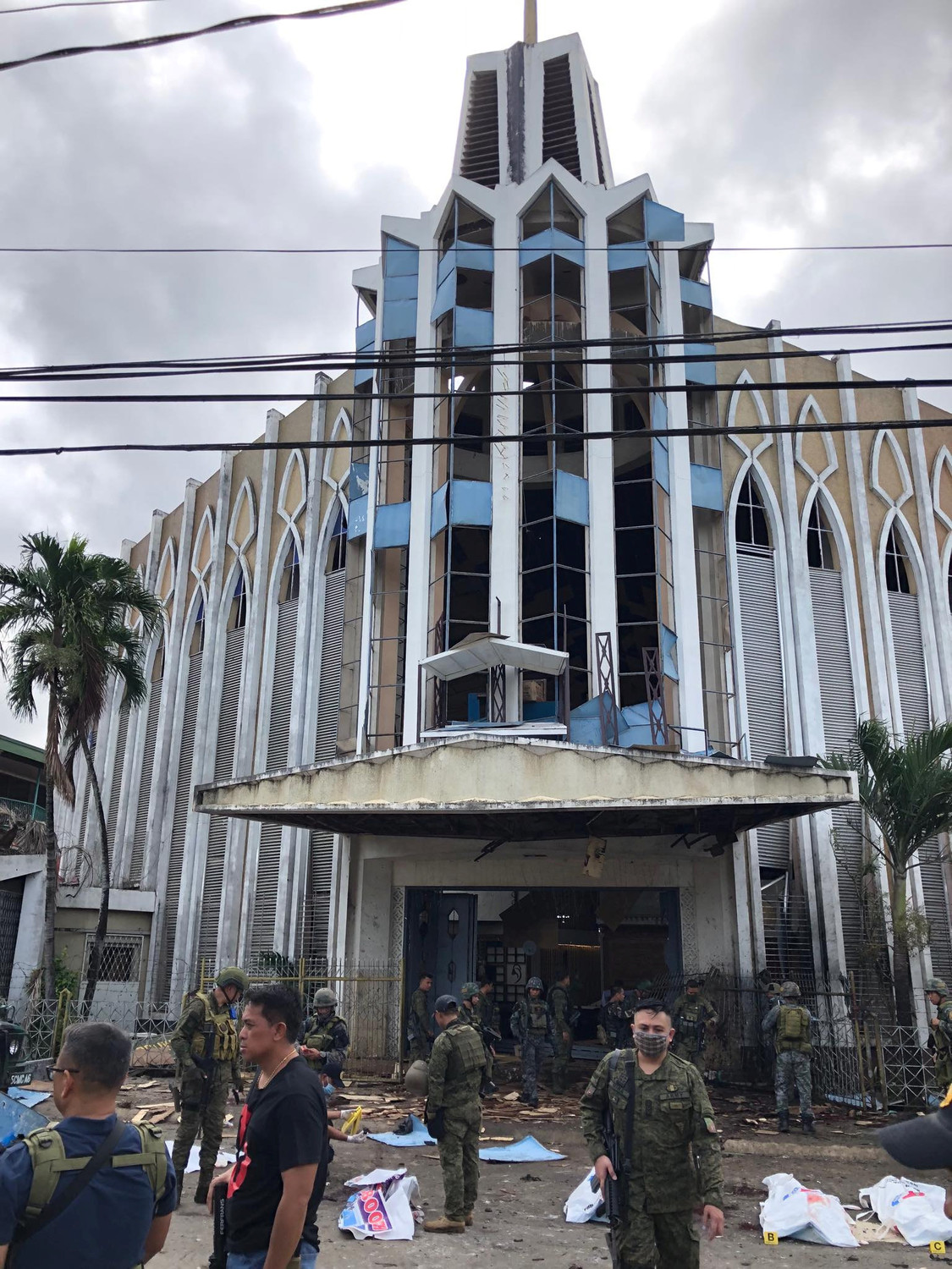 Philippine Army members secure the area outside the Cathedral of Our Lady of Mount Carmel Jan. 27, 2019, on the southern Philippine island of Jolo.