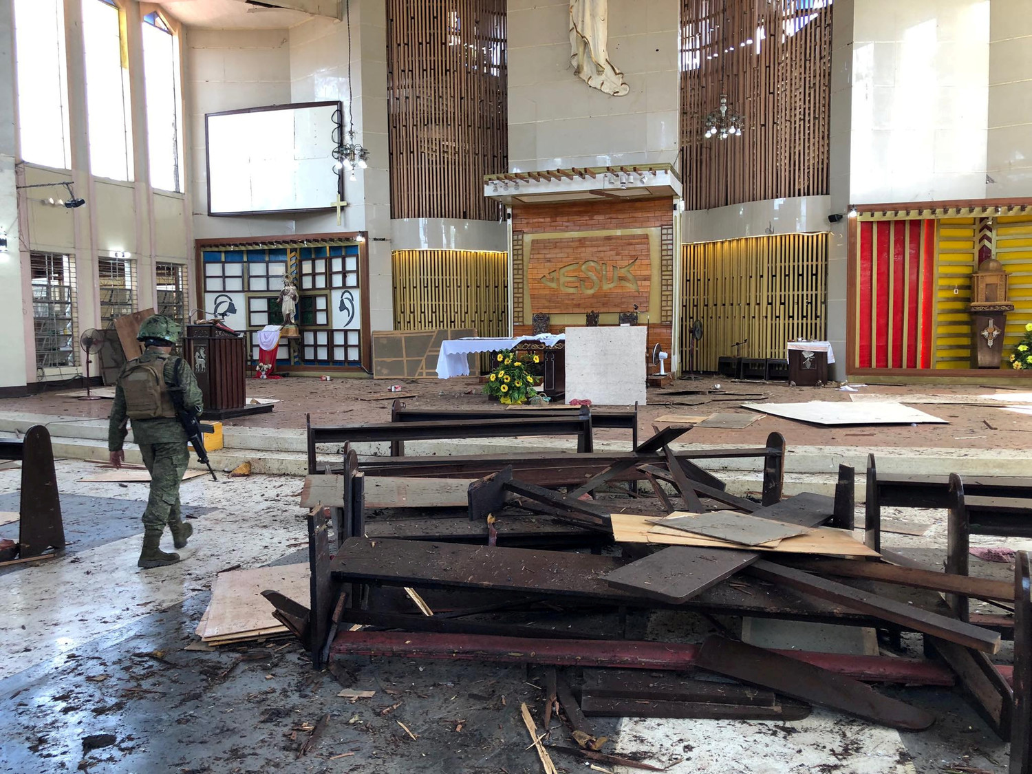 A Philippine army member inspects damage inside the Cathedral of Our Lady of Mount Carmel following a bomb blast in Jolo Jan. 27, 2019. The explosion, just before morning Mass, killed at least 20 people and wounded dozens of others.