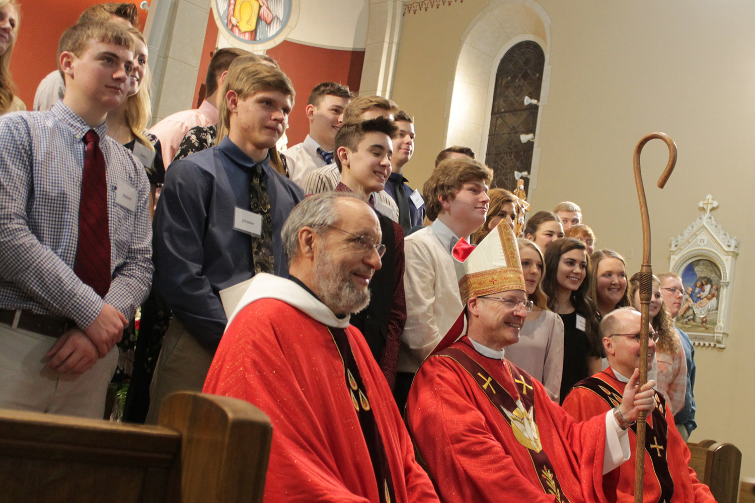 Bishop W. Shawn McKnight, along with Father James Finder and Father William Debo, join newly confirmed members of the Rich Fountain, Freeburg and Argyle parishes shortly after Bishop McKnight's installation in 2018.