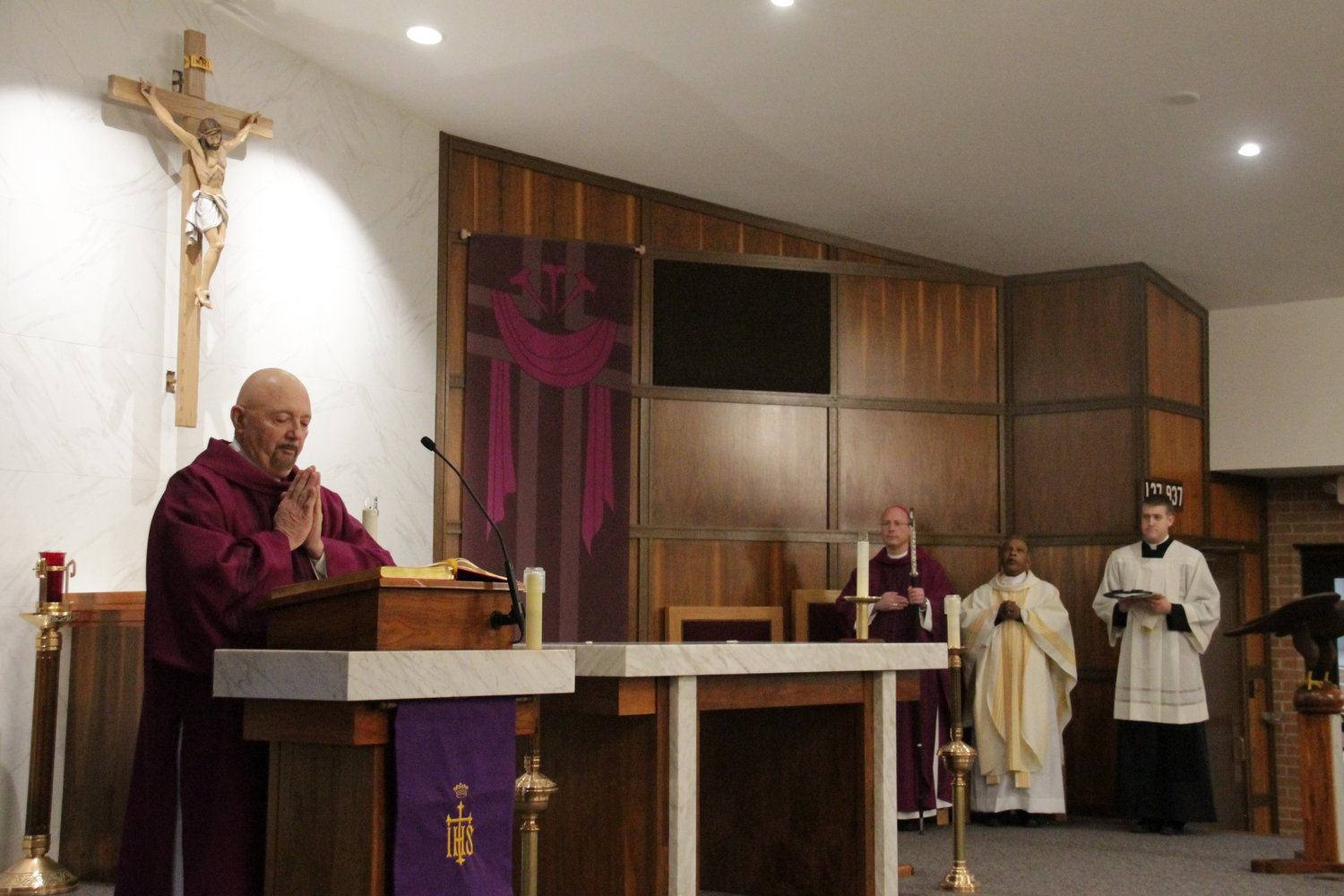 Deacon Chet Zuck proclaims the Gospel reading at Mass March 9, the evening Bishop W. Shawn McKnight blessed the newly renovated Sacred Heart Church in Eldon.