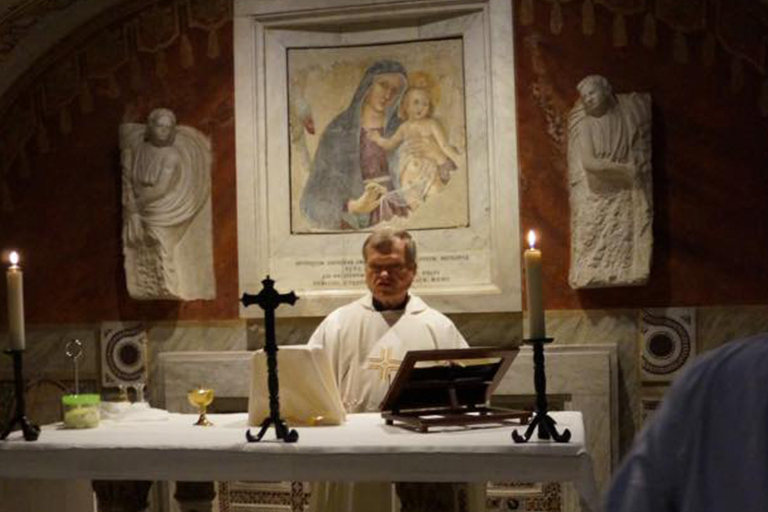 Father Mike Quinn offers Mass in a chapel of St. Peter's Baslica in Rome in this Nov. 23, 2016, file photo.