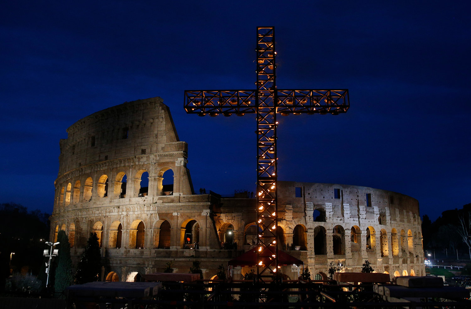 Rome's Colosseum is illuminated during the Way of the Cross March 30, 2018. Pope Francis has asked Missionary Sister Eugenia Bonetti, a long-time activist in the fight against human trafficking, to write the meditations for his celebration of the Good Friday Way of the Cross prayer service at Rome's Colosseum April 19, 2019.