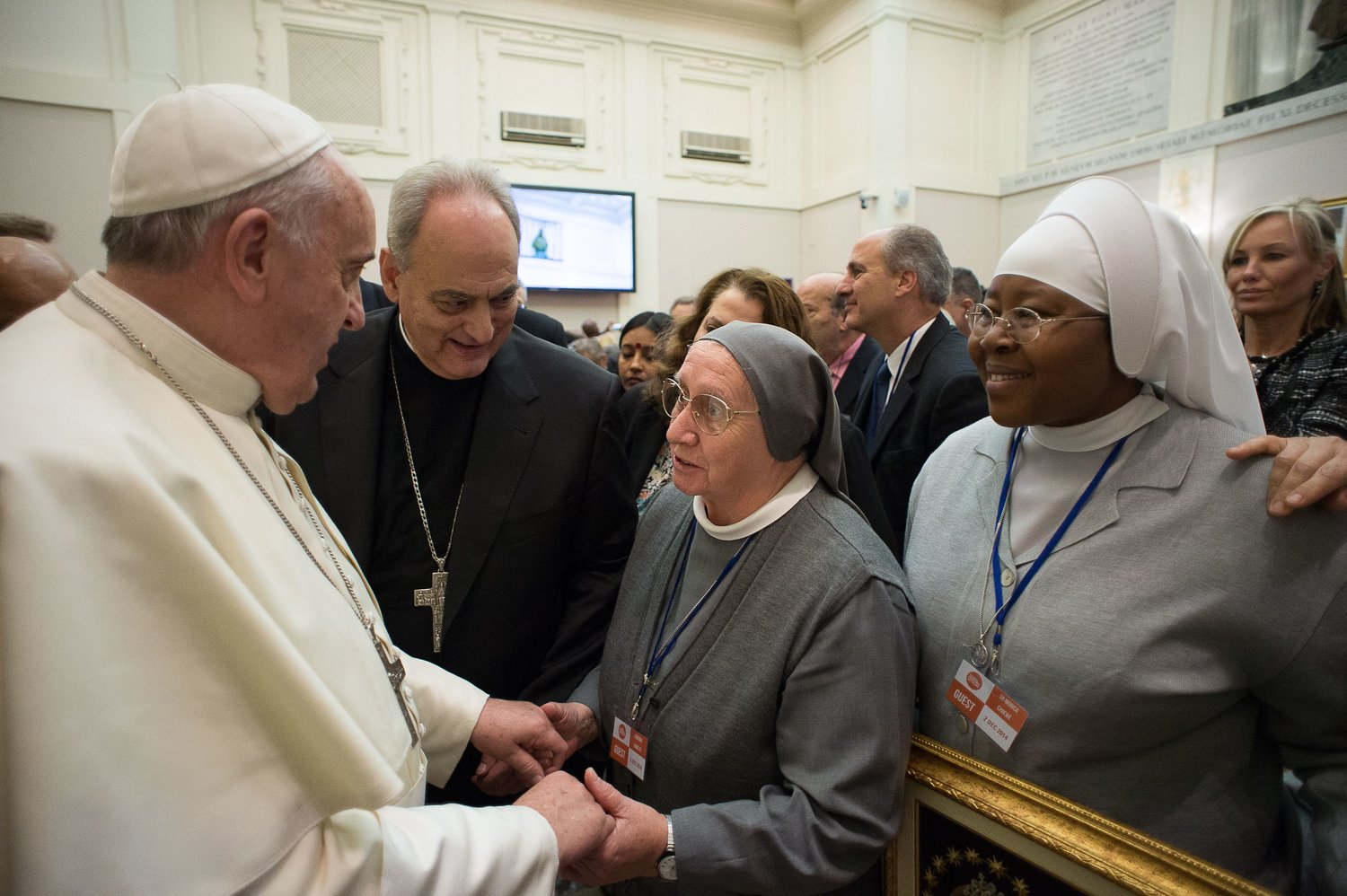 Pope Francis greets Consolata Missionary Sister Eugenia Bonetti in this Dec. 2, 2014, file photo. Pope Francis has asked Sister Bonetti, a long-time activist in the fight against human trafficking, to write the meditations for his celebration of the Good Friday Way of the Cross prayer service at Rome's Colosseum April 19, 2019.