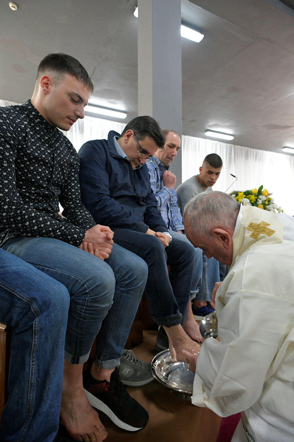 Pope Francis washes the feet of an inmate during a Holy Thursday celebration at Velletri Correctional Facility, 36 miles south of Rome.