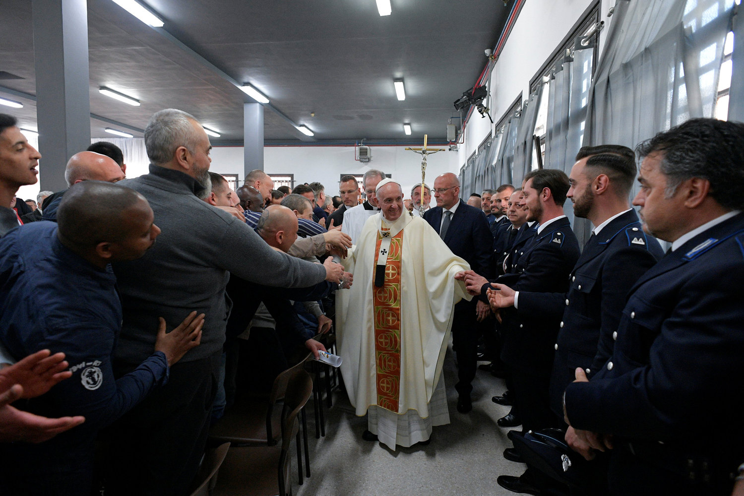 Pope Francis greets inmates and guards as he arrives to celebrate the Mass of Lord's Supper April 18, 2019, at Velletri Correctional Facility, 36 miles south of Rome.