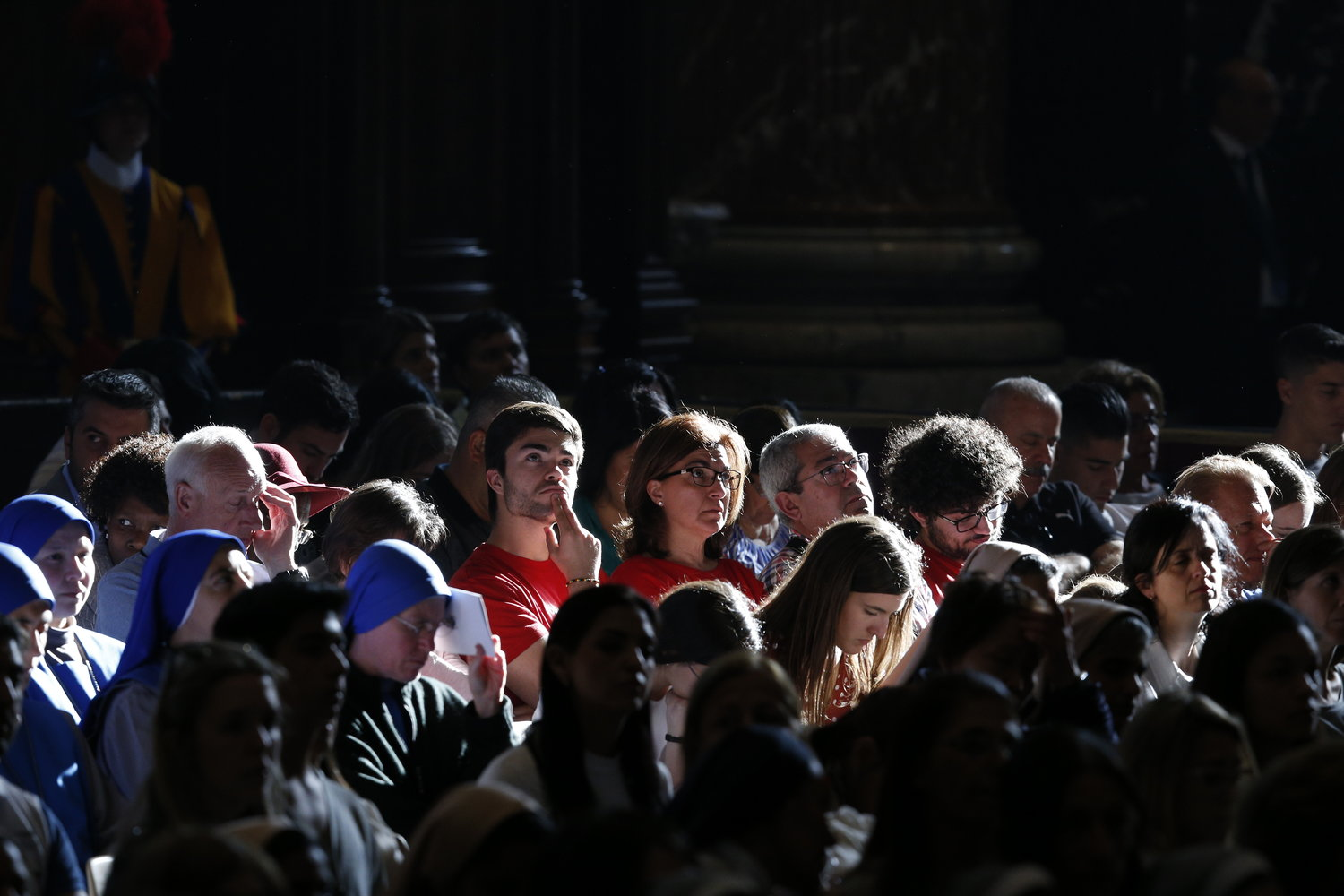 People listen as Capuchin Father Raniero Cantalamessa, the preacher of the papal household, delivers the homily during the Good Friday Liturgy of the Lord's Passion April 19, 2019, in St. Peter's Basilica.