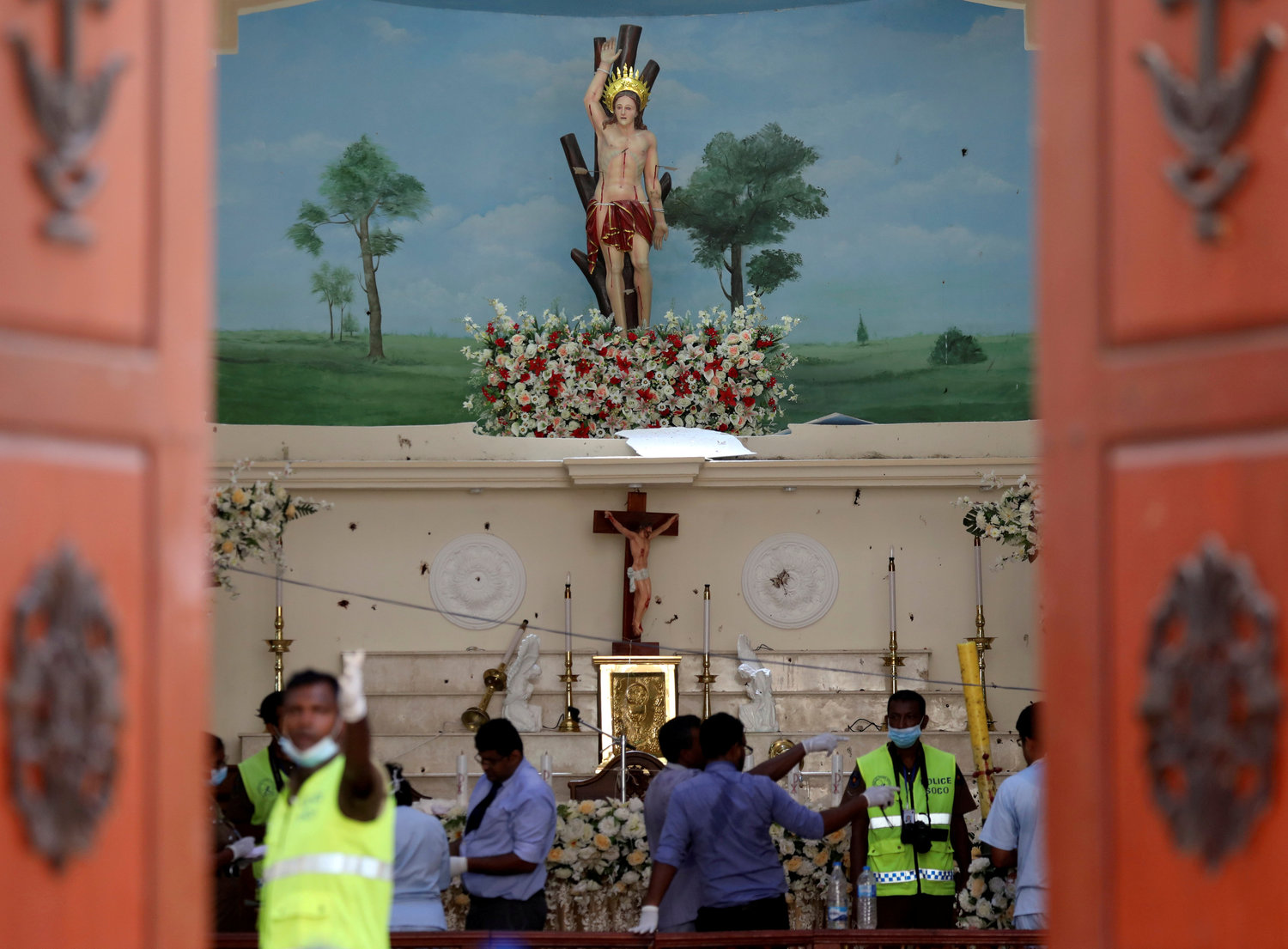 Police officers work the scene at St. Sebastian Catholic Church in Negombo, Sri Lanka April 22, 2019, after bomb blasts ripped through churches and luxury hotels the previous dauy. Sri Lankan officials reported 290 confirmed deaths from the eight blasts at churches and hotels in three cities.
