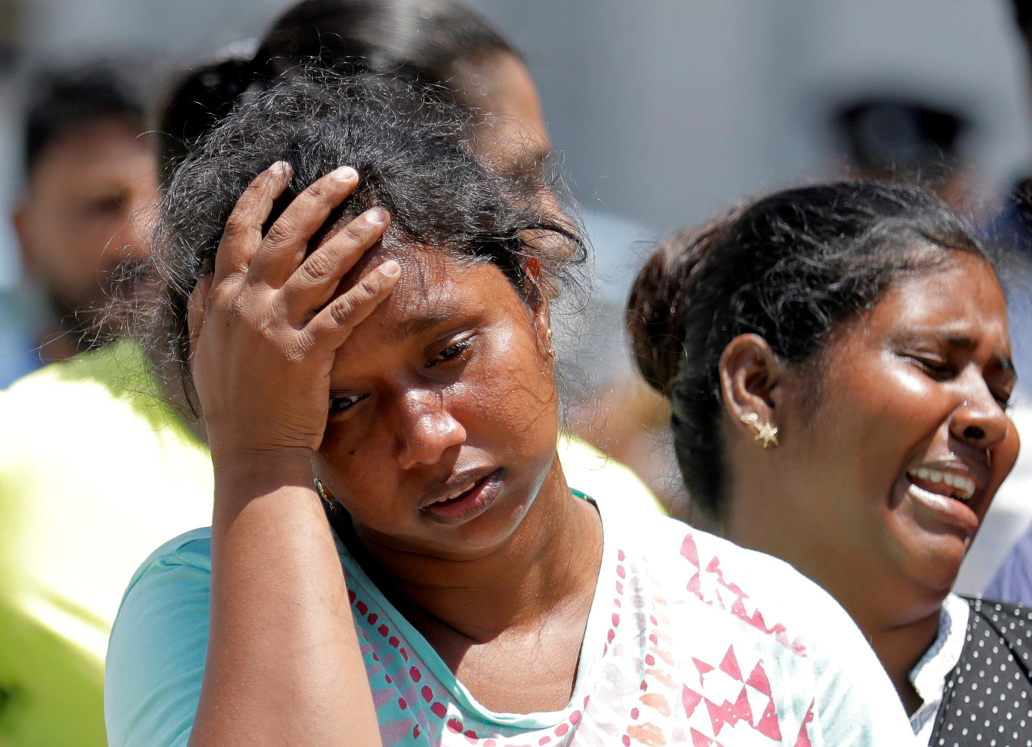 Relatives of victims react at a police mortuary in Colombo, Sri Lanka, after bomb blasts ripped through churches and luxury hotels on Easter April 22, 2019. Sri Lankan officials reported 290 confirmed deaths from the eight blasts at churches and hotels in three cities in apparently coordinated attacks.