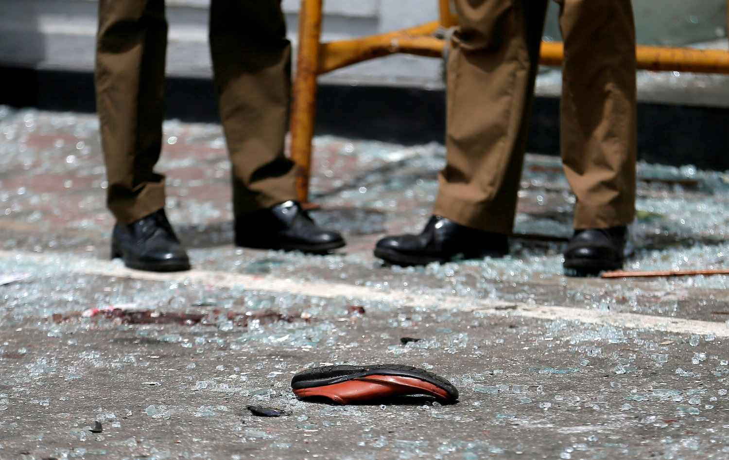 The shoe of a victim is seen in front of St. Anthony's Shrine in Colombo, Sri Lanka April 21, 2019. Sri Lankan officials reported 290 confirmed deaths from eight blasts at churches and hotels in three cities in apparently coordinated Easter attacks.