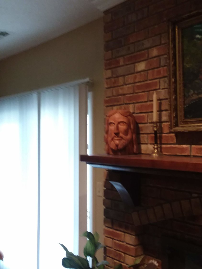 Deacon Fred Weisel carved this image of Jesus' head on his mentle.