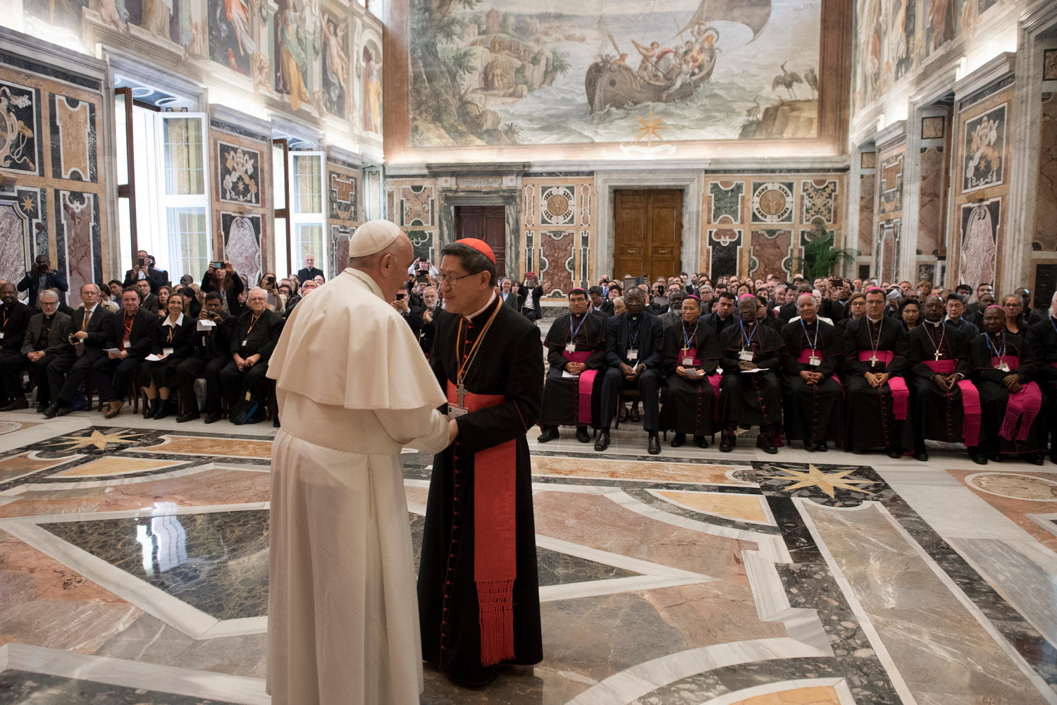 Philippine Cardinal Luis Antonio Tagle of Manila, president of the Catholic Biblical Federation, greets Pope Francis April 26, 2019, at the Vatican during a special audience marking the federation's 50th anniversary.