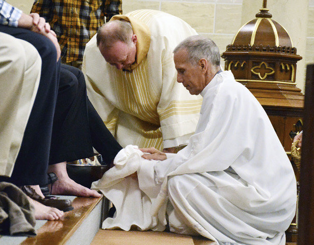Father Charles Pardee washes parishioners' feet during the Mass of the Lord's Supper on Holy Thursday in 2018.