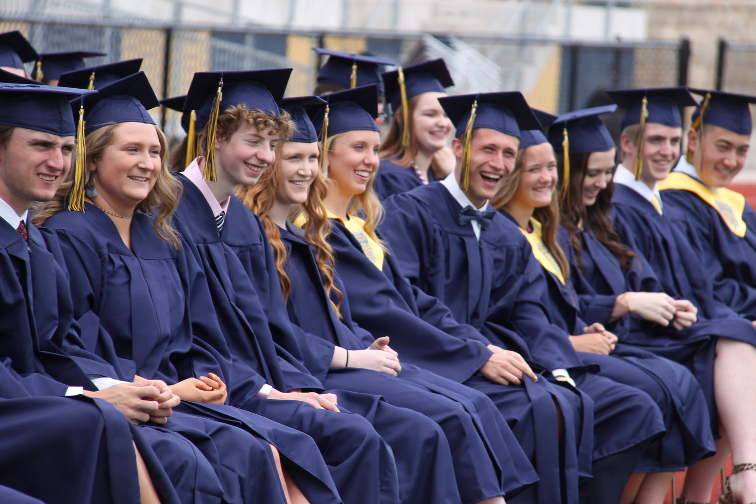 Graduating seniors of Helias Catholic High School listen to graduation speaker Pat Seifert during their Commencement ceremony.