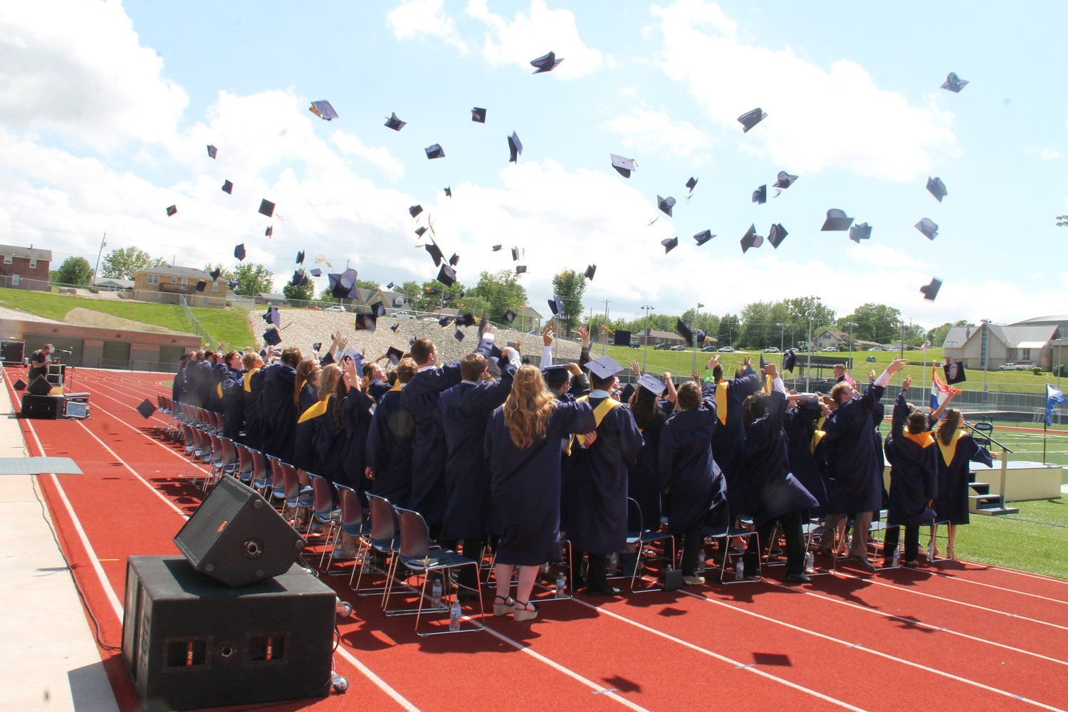 Members of the Helias Catholic High School Class of 2019 toss their mortarboards into the air at the end of their Commencement ceremony.