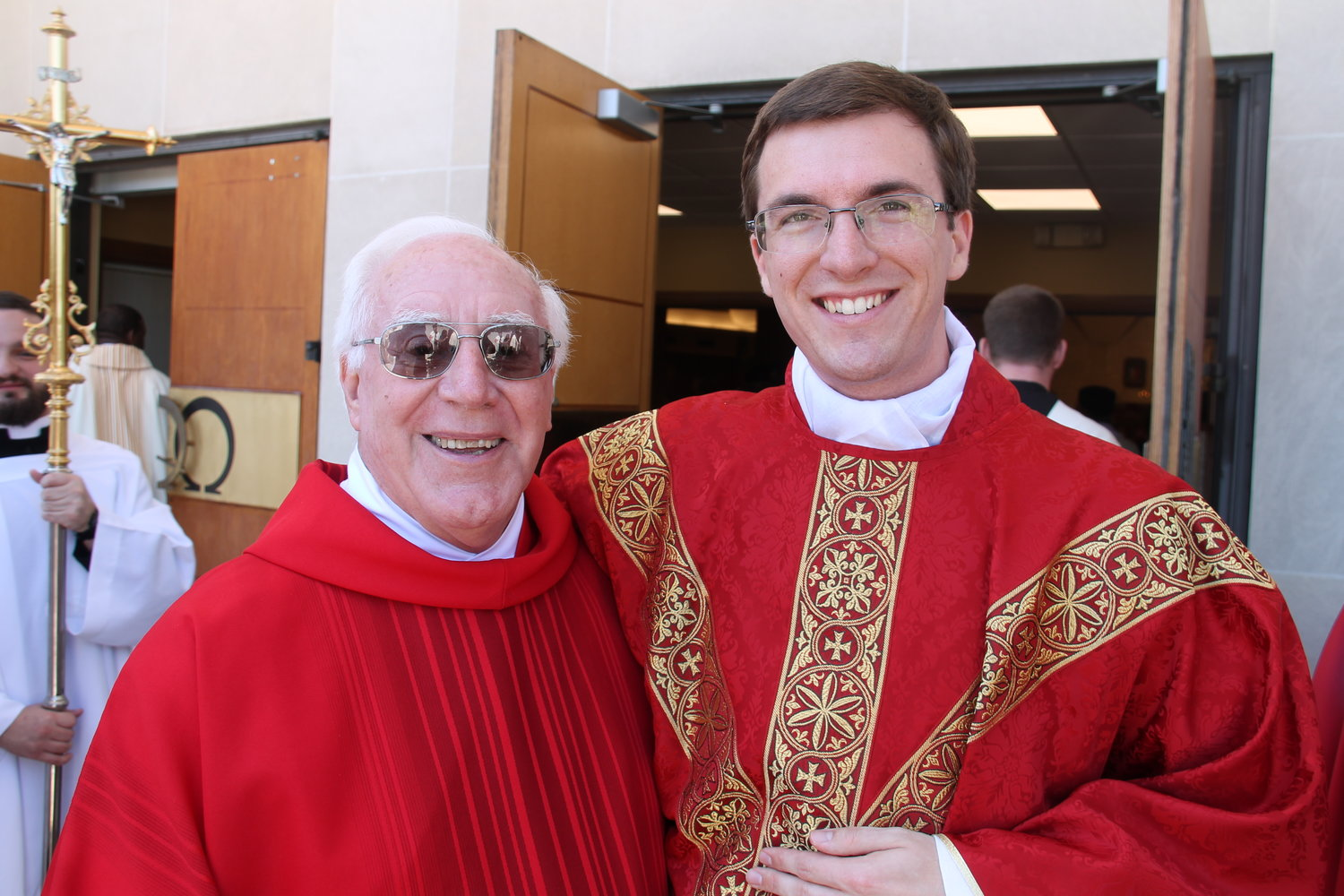 Deacon Francis Butel, who baptized Fr. Berhorst and was present at his First Holy Communion and confirmation, stands with Fr. Berhorst.