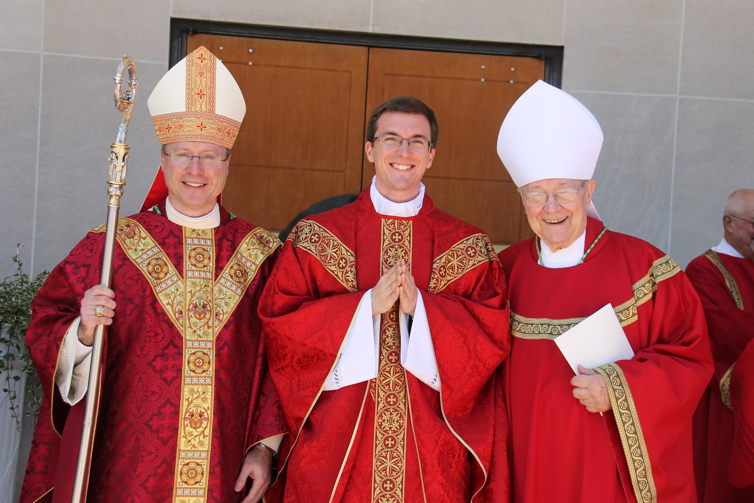 Bishop McKnight, Fr. Berhorst and Bishop Emeritus John R. Gaydos stand outside the cathedral after the Ordination Mass.