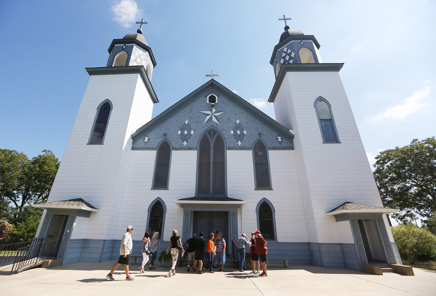Parishioners enter the historic 124-year-old Church of the Visitation Oct. 7, 2017, in Westphalia, Texas. The church was destroyed in a fire the morning of July 29, 2019. The parish has served the Catholic community of southwestern Falls County, many of them immigrants from the northwest German region of Westphalia, since 1883.