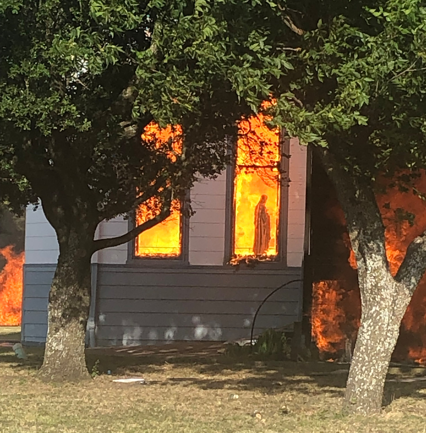 A statue of Mary is seen amid flames through a window in the Church of the Visitation in Westphalia, Texas, July, 29, 2019. The nearly 125-year old wooden church with bell towers on each side, burned to the ground that morning. Since 1883 the parish has served the Catholic community of southwestern Falls County, many of whom are descendents of immigrants from the northwest German region of Westphalia.