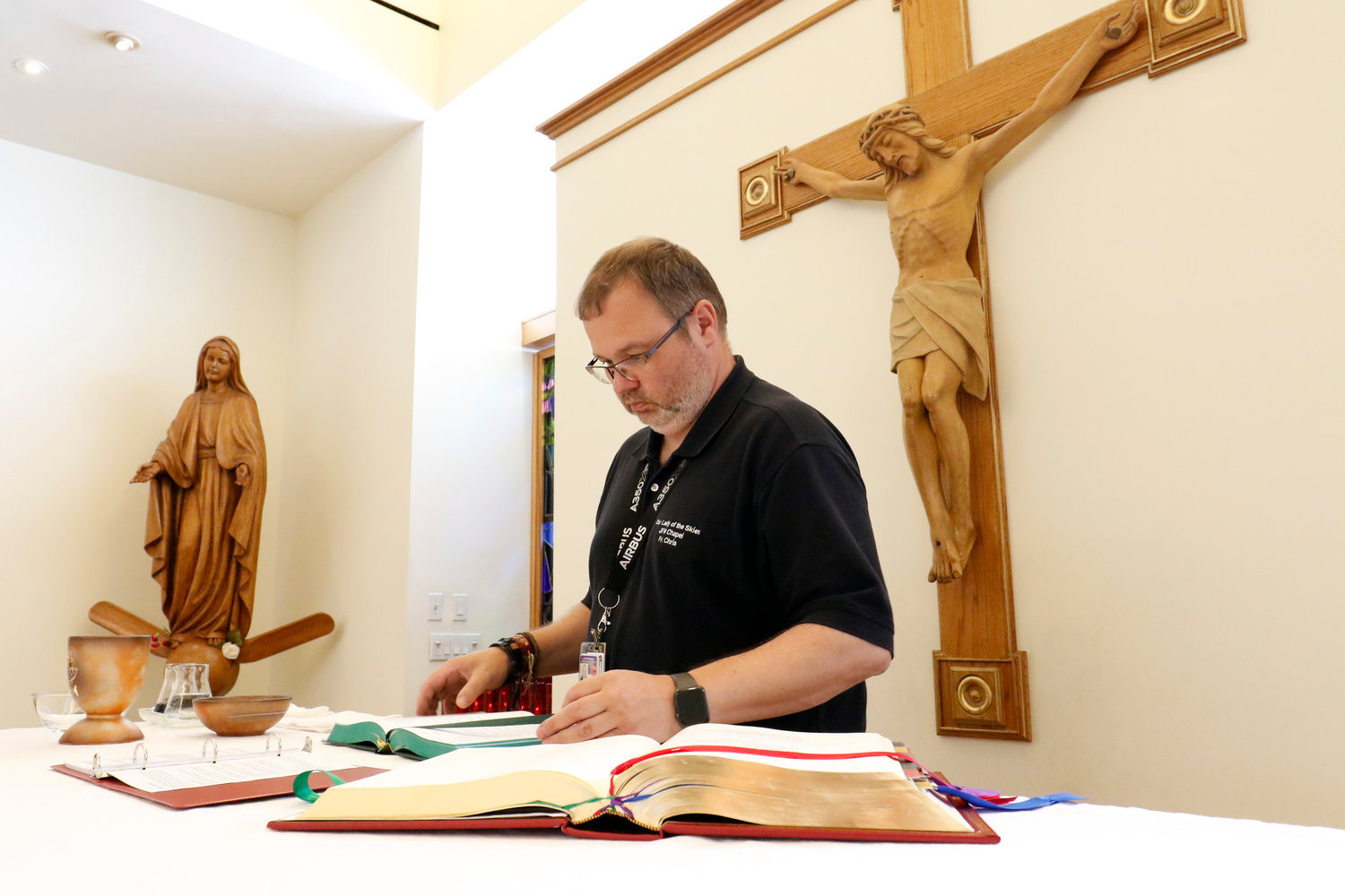 Father Chris Piasta, Catholic chaplain at John F. Kennedy International and LaGuardia airports in the Queens borough of New York, prepares the altar prior to celebrating Mass at JFK's Our Lady of the Skies Chapel Aug. 5, 2019.