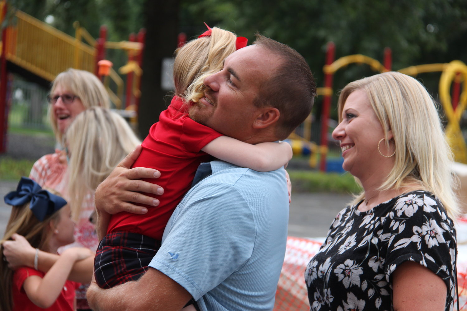 Kindergartners at St. Joseph School in Salisbury hug their parents after Mass on the first day of school.