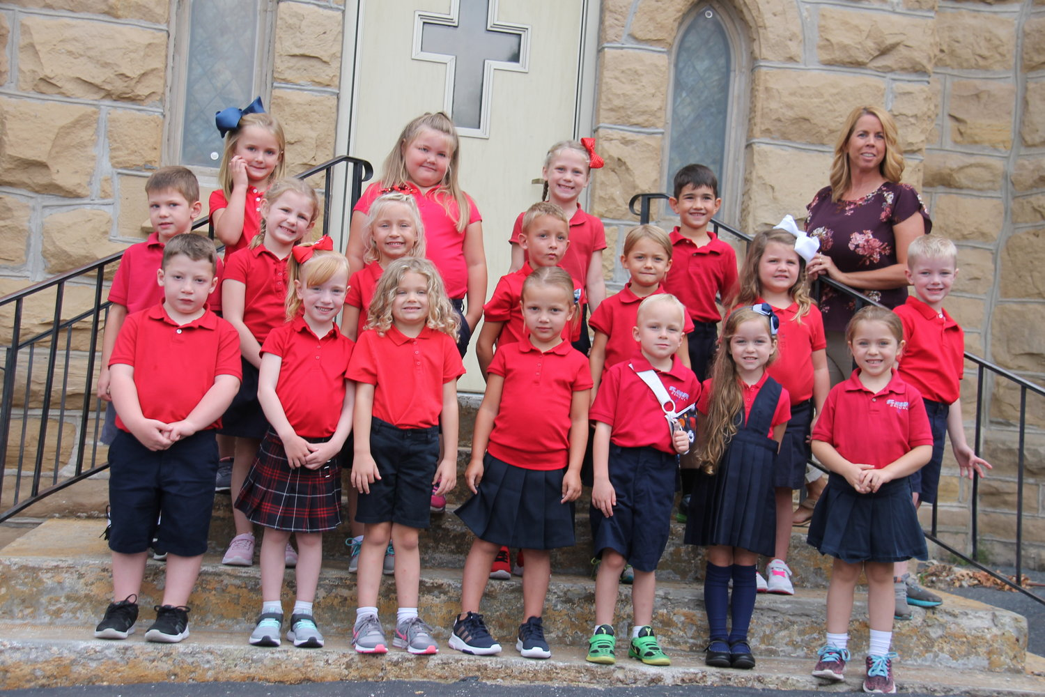 The class of 18 kindergarteners gather for a photo on the steps of St. Joseph Church in Salisbury on their first day of school.