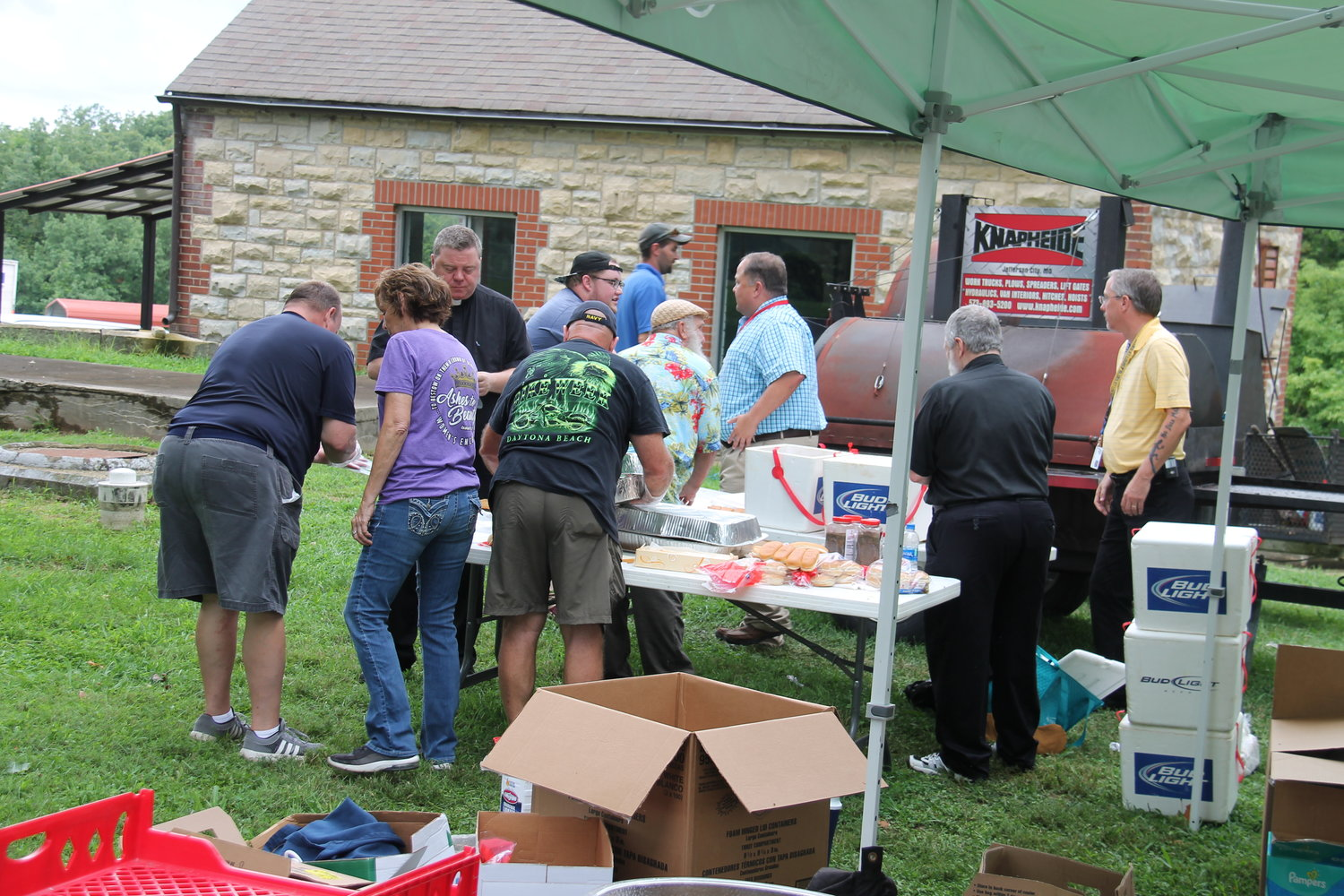 The volunteer cooking crew assembles meals to send into the Algoa and Jefferson City correctional centers for people on the late shift, during a thank-you barbecue for prison personnel, sponsored by Catholic Charities of Central and Northern Missouri.