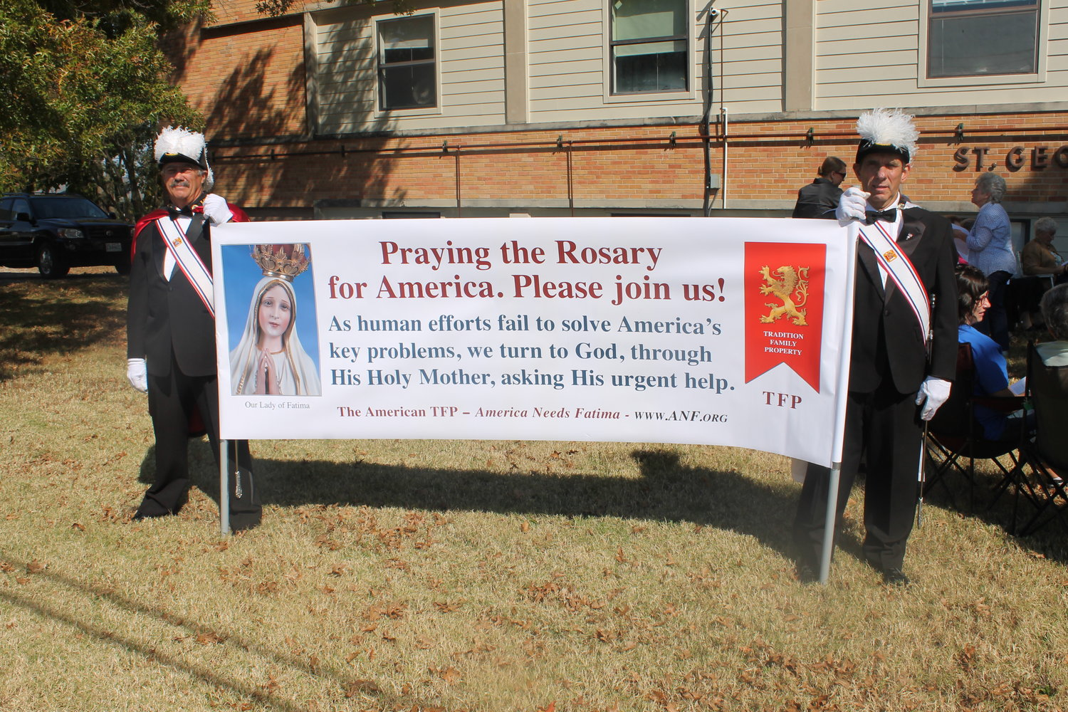 Fourth Degree Knights of Columbus carry a banner for a recent Public Rosary in the Square observance in Linn.