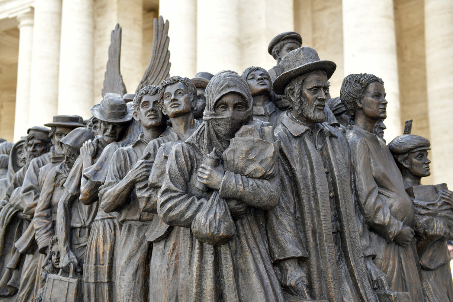 Migrants and refugees are pictured on a large bronze statue in St. Peter's Square at the Vatican Sept. 29, 2019. Pope Francis attended the unveiling of the statue after celebrating a Mass for World Day of Migrants and Refugees. (CNS photo/Paolo Galosi, pool) See POPE-MASS-MIGRANTS-REFUGEES Sept. 29, 2019.
