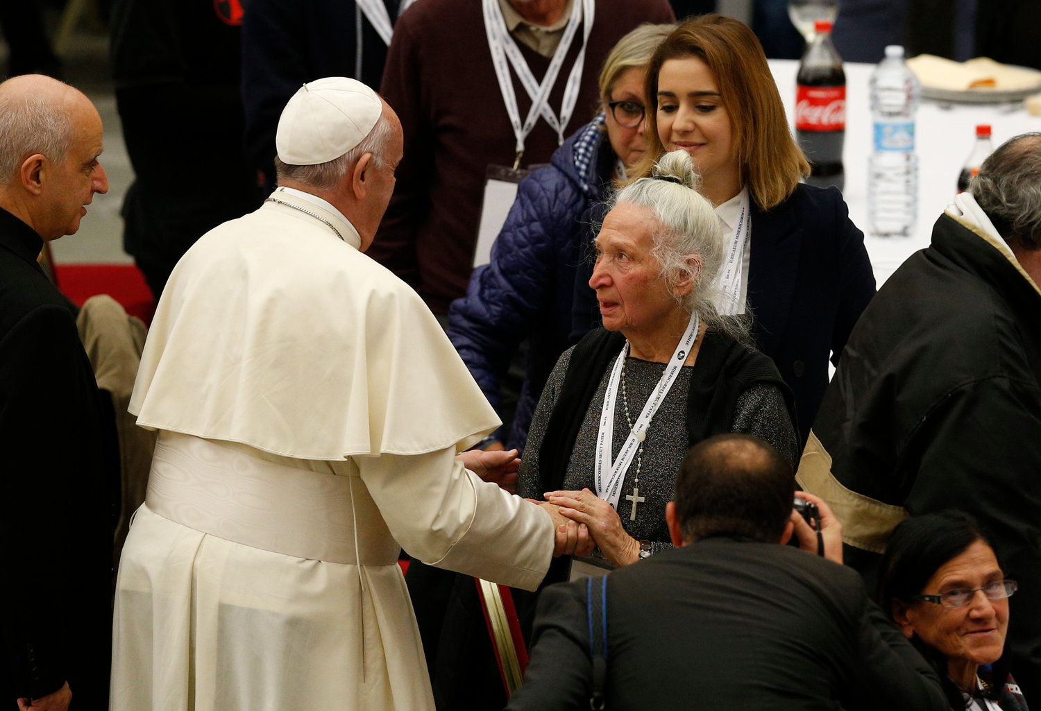 Pope Francis greets a woman as he arrives to eat lunch with the poor in the Paul VI hall as he marks World Day of the Poor at the Vatican Nov. 17, 2019.