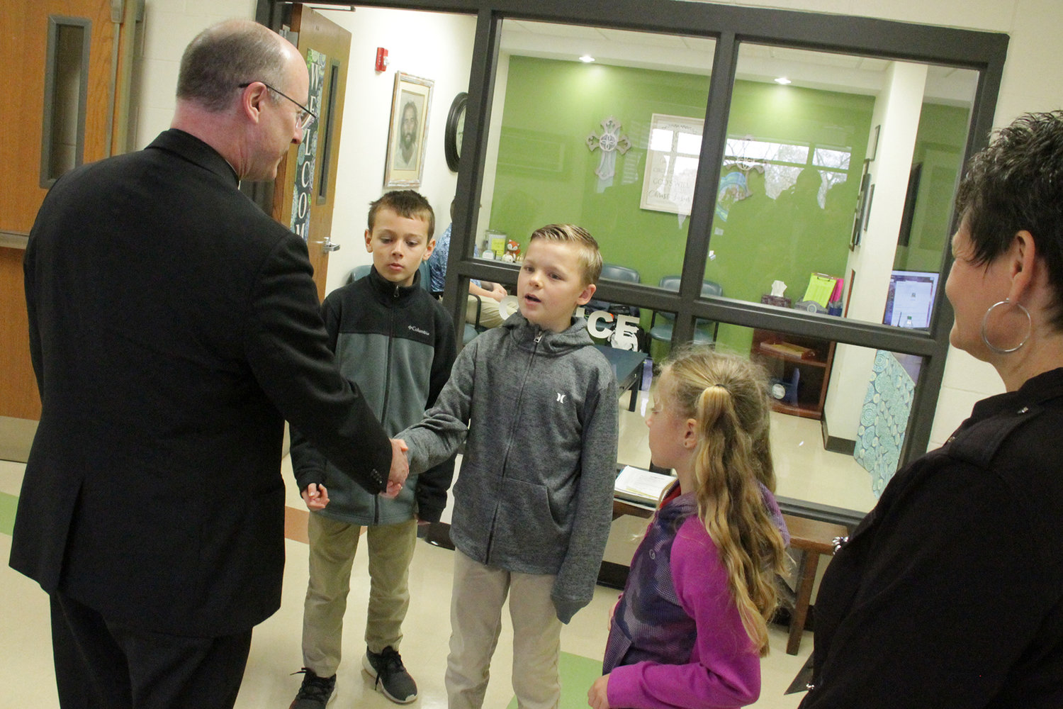 Third-graders at St. Martin School in St. Martins say goodbye to Bishop McKnight and thank him for visiting.