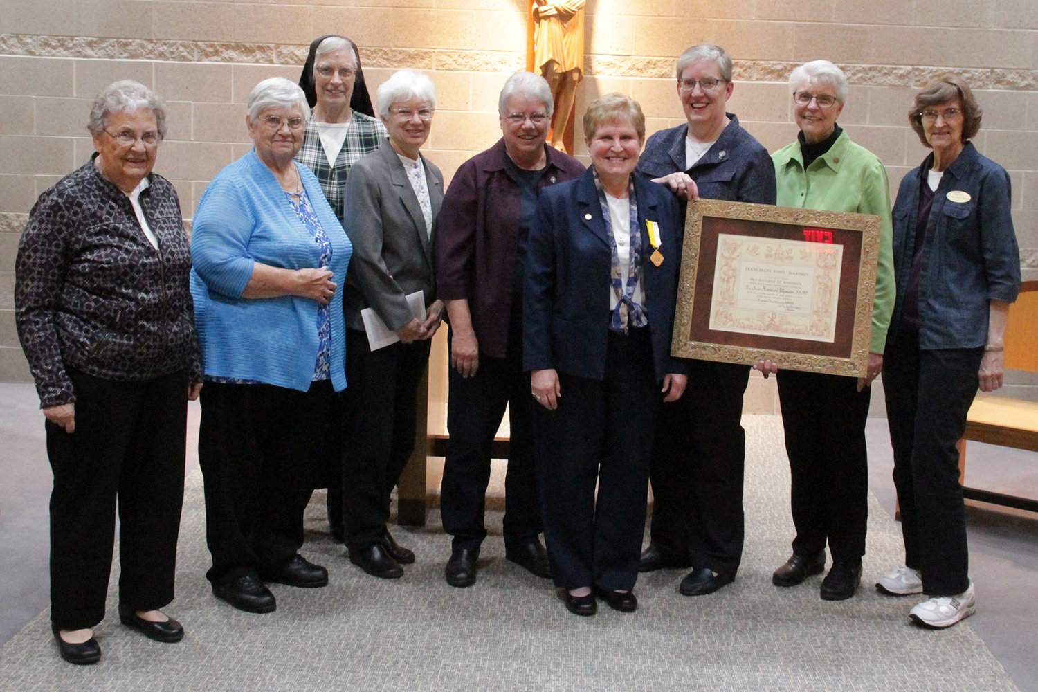 Sister Bernita Wasinger, Sister Anne Boessen, Sister Mary Ruth Wand, Sister Francine Koehler, Sister Jean Dietrich, Sister Julie Brandt, Sister Barbara Neist and Sister Mary Helen Stokes — who are all School Sisters of Notre Dame (SSNDs) — gather in the chapel of the Alphonse J. Schwartze Memorial Catholic Center in Jefferson City with Sister Kathleen Wegman SSND (fourth from right) at a celebration for her retirement from full-time ministry.