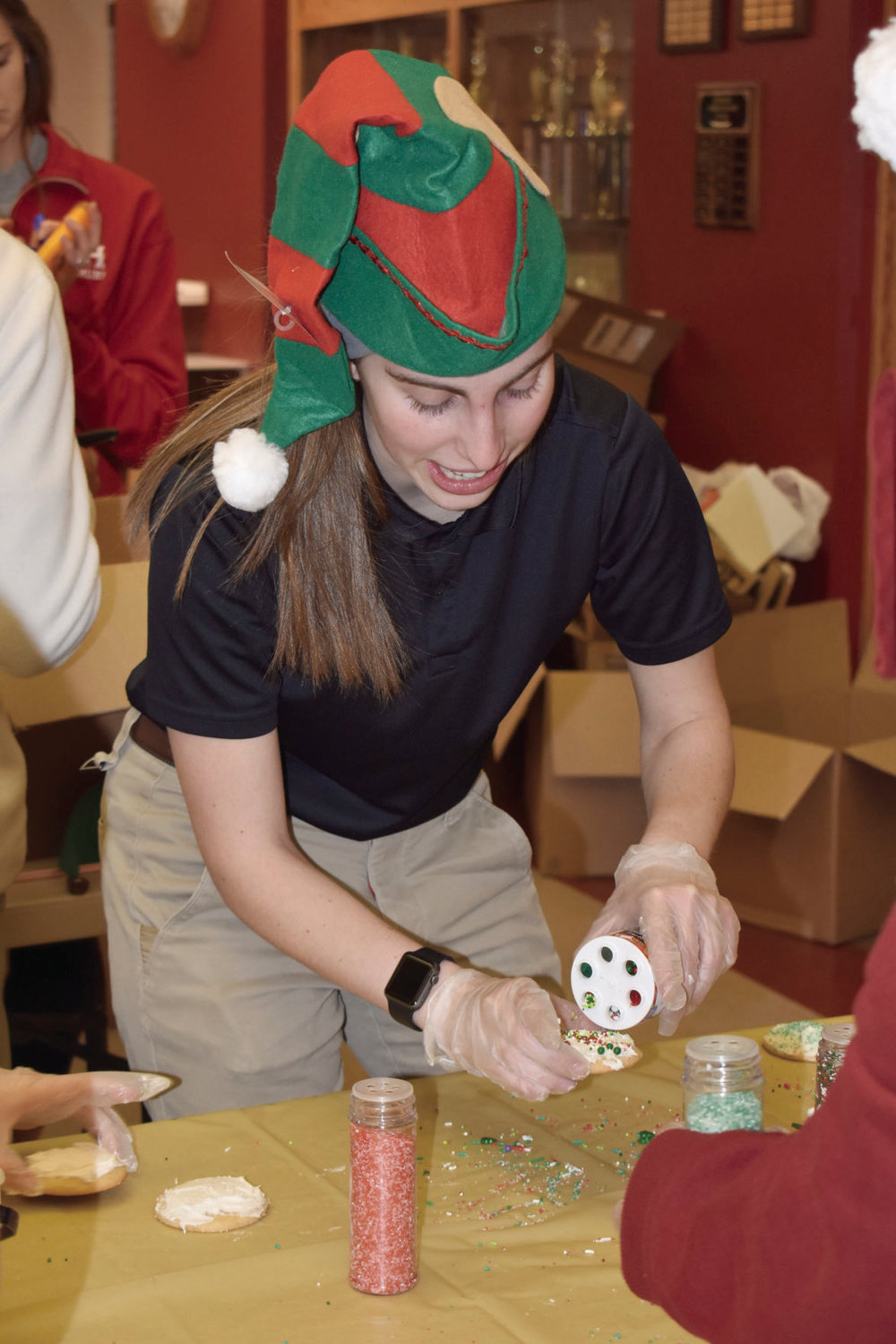 Blaise Wilt decorates Christmas cookies for the stockings.