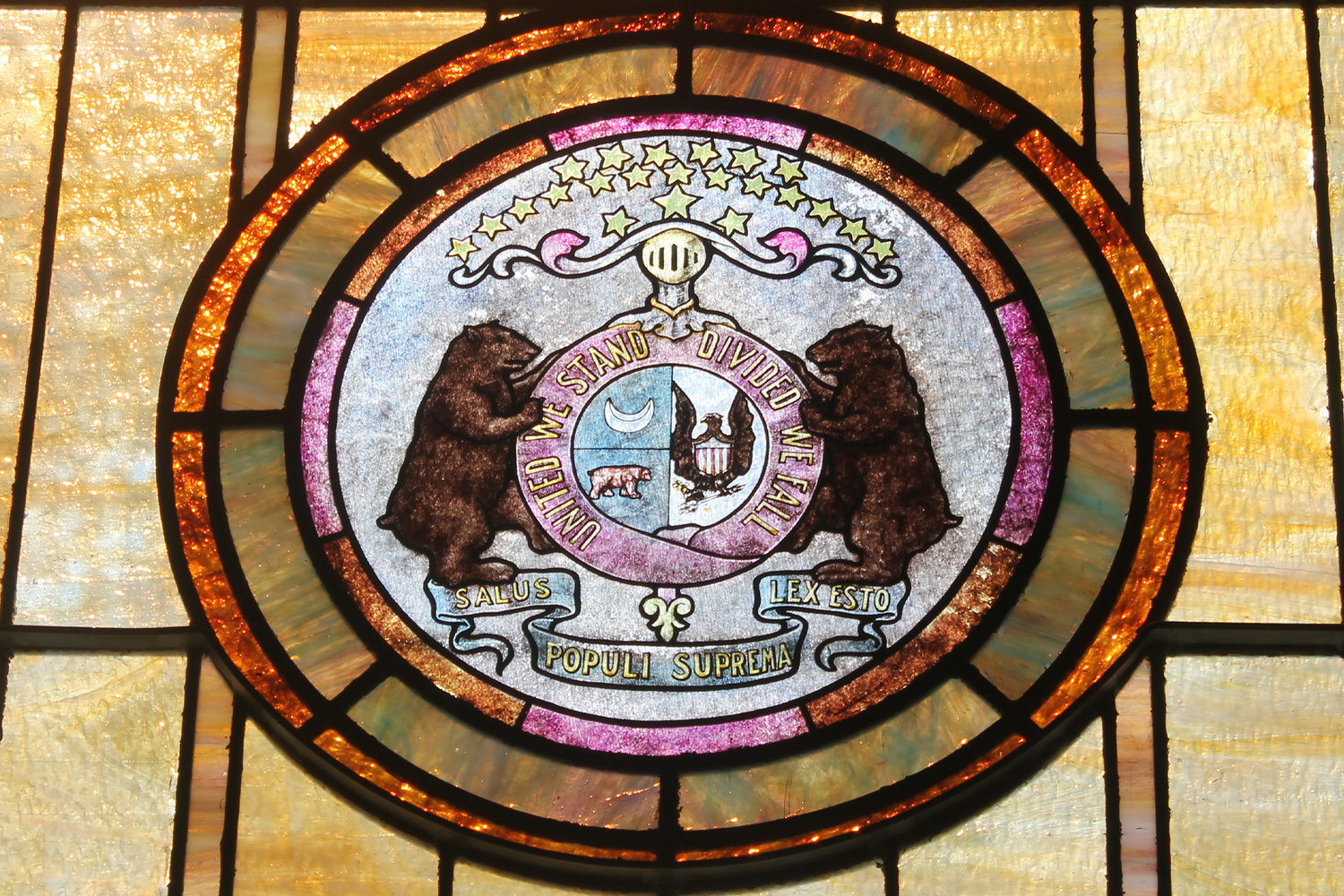 The Great Seal of the State of Missouri is rendered in stained glass in a window in St. Mary parish in Milan.