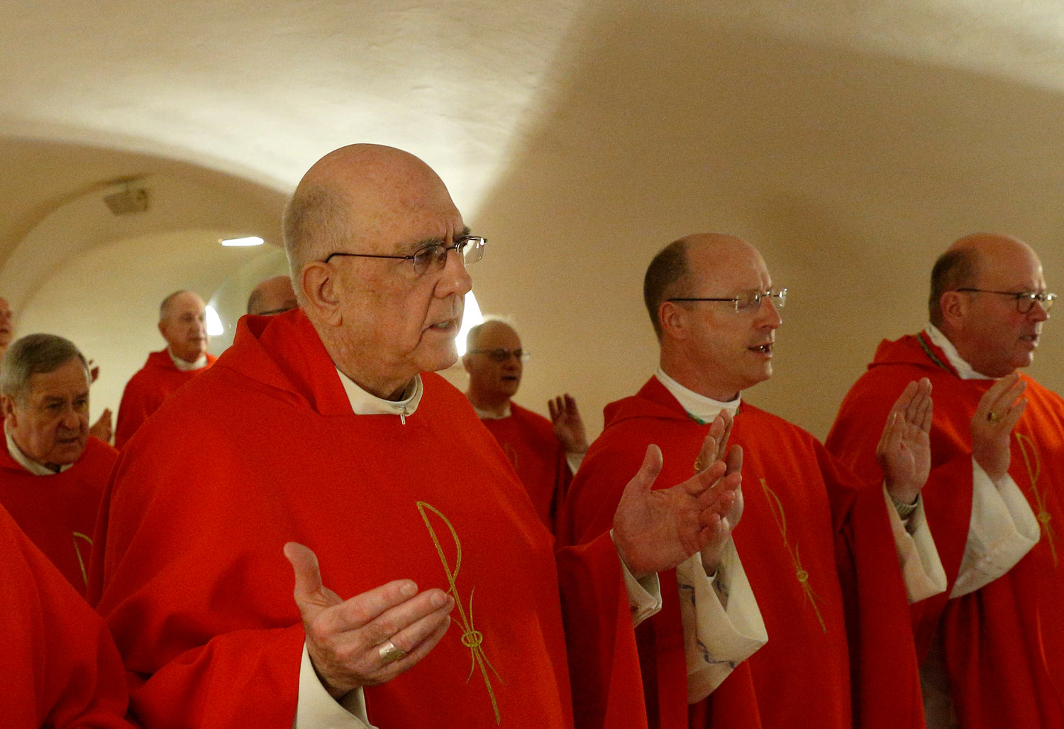 "Archbishop Joseph F. Naumann of Kansas City, Kan., left, Bishop W. Shawn McKnight of Jefferson City, Mo., and Bishop Carl A. Kemme of Wichita, Kan., pray the Lord's Prayer as U.S. bishops from Iowa, Kansas, Missouri and Nebraska concelebrate Mass in the crypt of St. Peter's Basilica at the Vatican Jan. 16, 2020. The bishops were making their ""ad limina"" visits to the Vatican to report on the status of their dioceses to the Pope and Vatican officials."