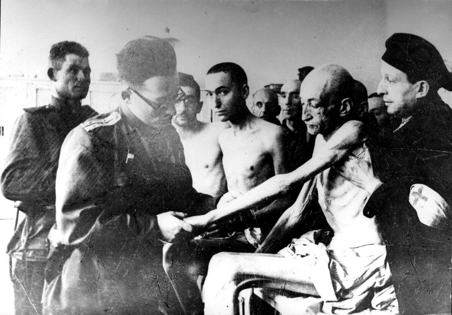 A Russian military doctor examines Holocaust survivors after the liberation of the Nazi death camp Auschwitz-Birkenau in 1945 in Oswiecim, Poland. Historians estimate that the Nazis sent at least 1.3 million people to Auschwitz between 1940-45, and it is believed that some 1.1 million of those perished there. Auschwitz was liberated by the Russian Army Jan. 27, 1945.
