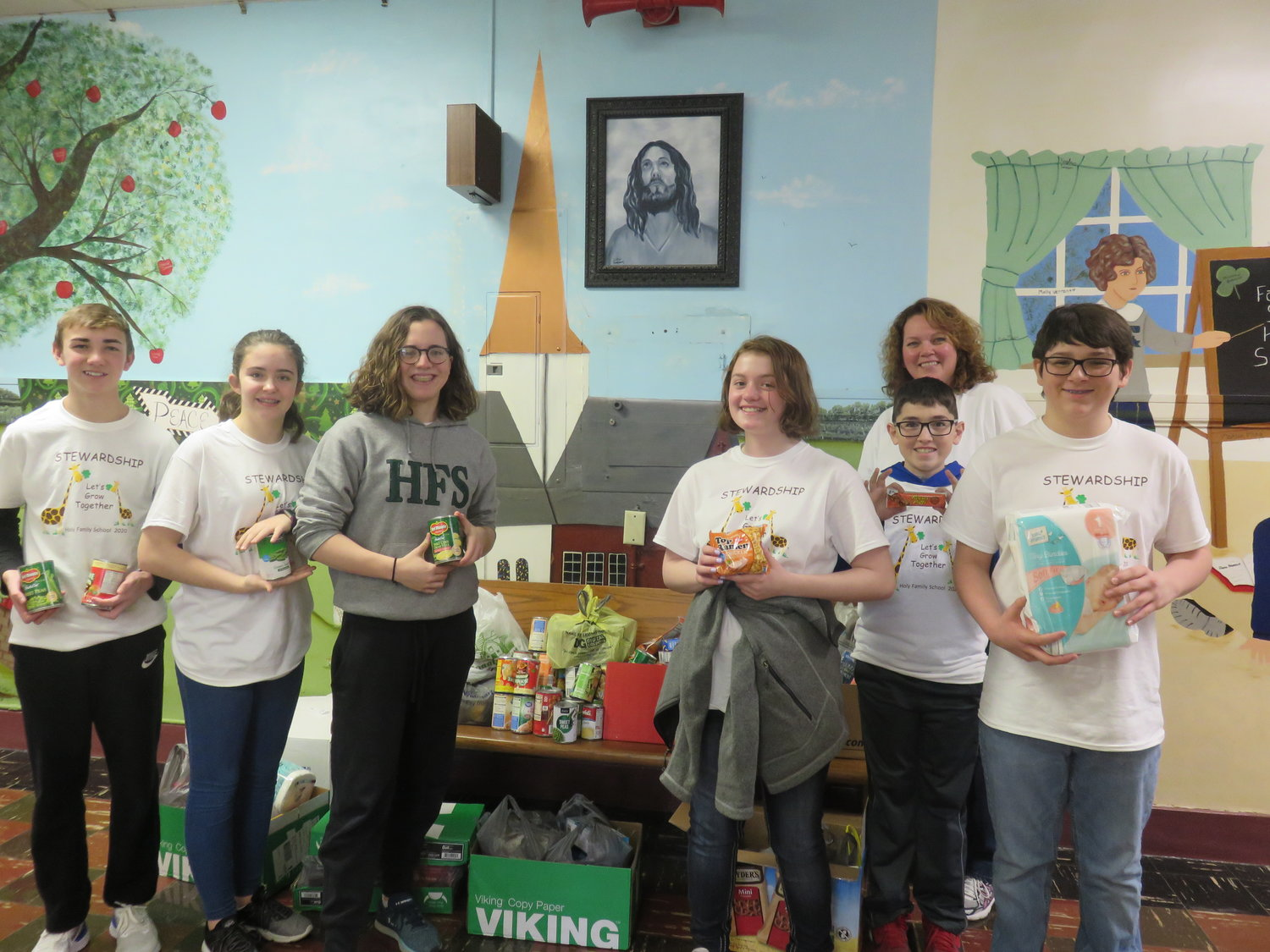 Eighth-graders at Holy Family School in Hannibal gather up the food and personal-care items collected for Holy Family parish's Good Neighbor Project for people in need.