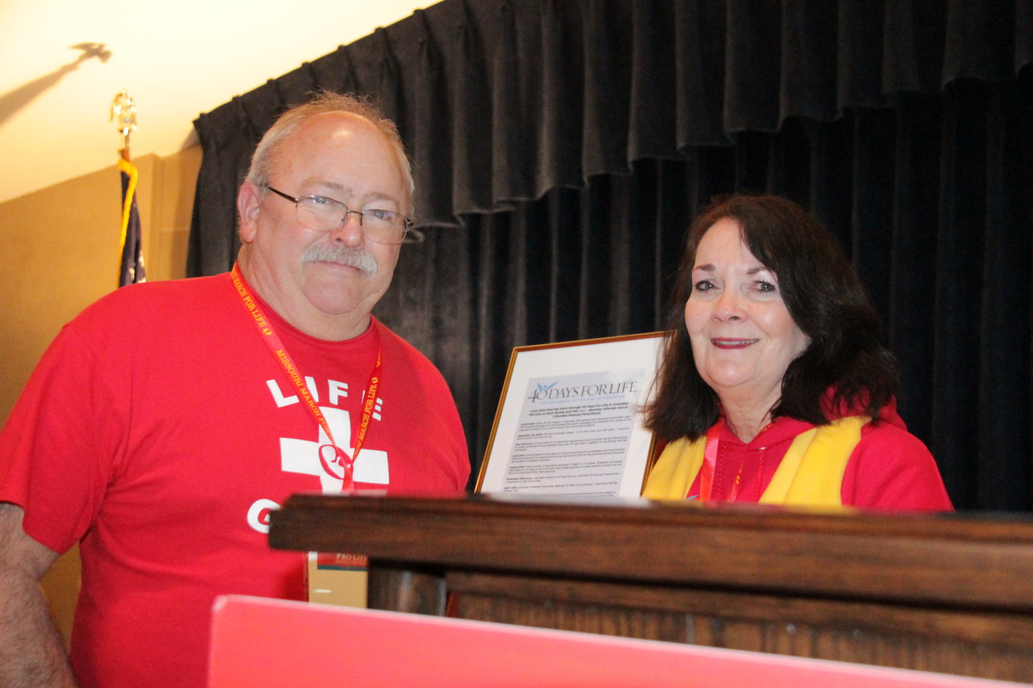 Mike and Kathy Forck, leaders of the Columbia 40 Days for Life Campaign and the Midwest March for Life, accept special recognition from 40 Days for Life during a rally at the end of this year's march.