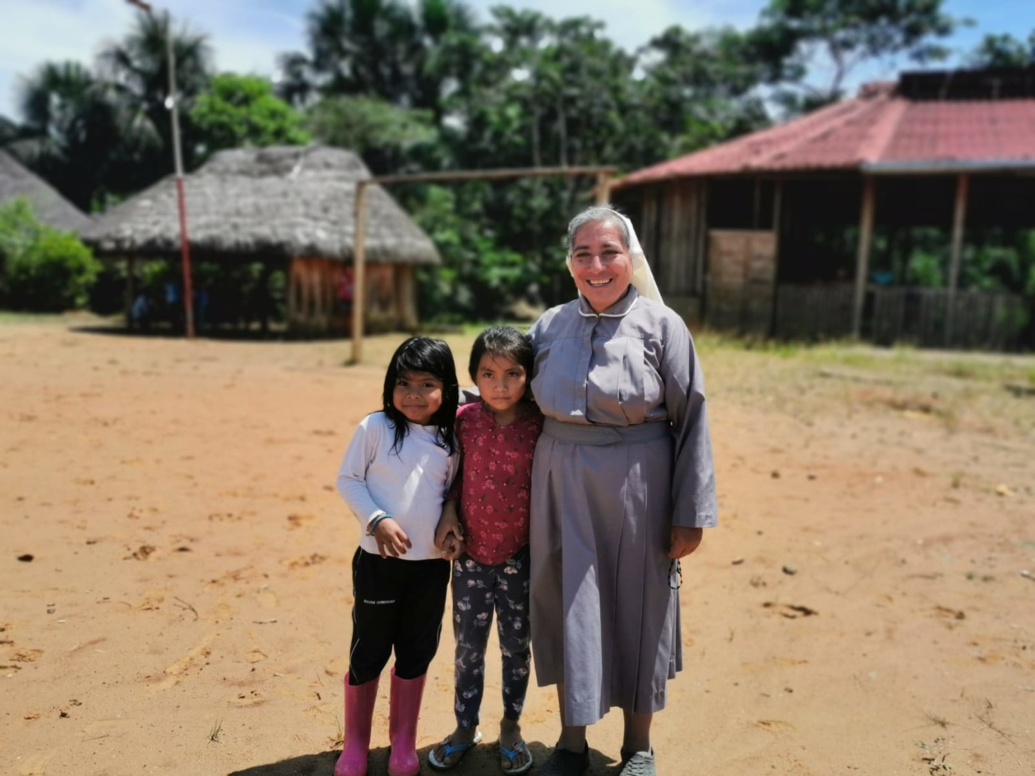Sister Rosa Elena Pico, a member of the Missionaries of Mary Co-Redemptrix, poses for a photo with children from the indigenous community of Sarayaku, Ecuador, Sept. 18, 2019. Sister Pico has worked and lived with the community since 2017 and occasionally leads the liturgy of the word in the absence of a priest.