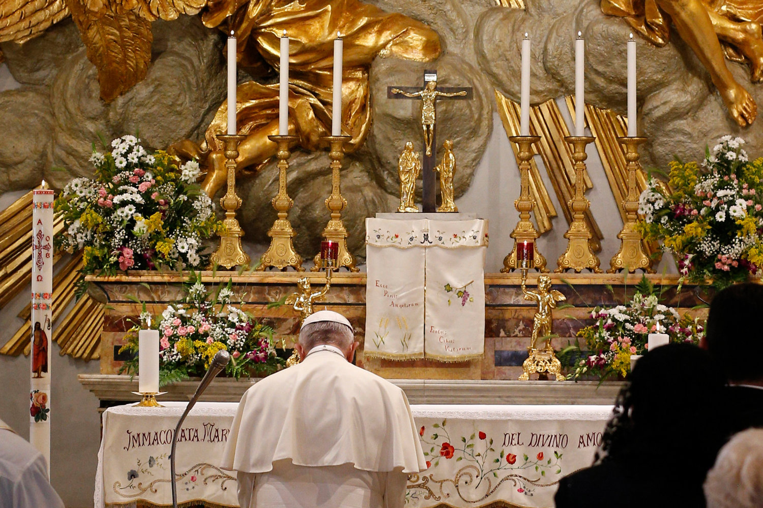 Pope Francis recites the rosary at the Shrine of Our Lady of Divine Love in Rome in this 2018 file photo. On March 11, 2020, in the midst of the COVID-19 pandemic, he entrusted the world to Mary.