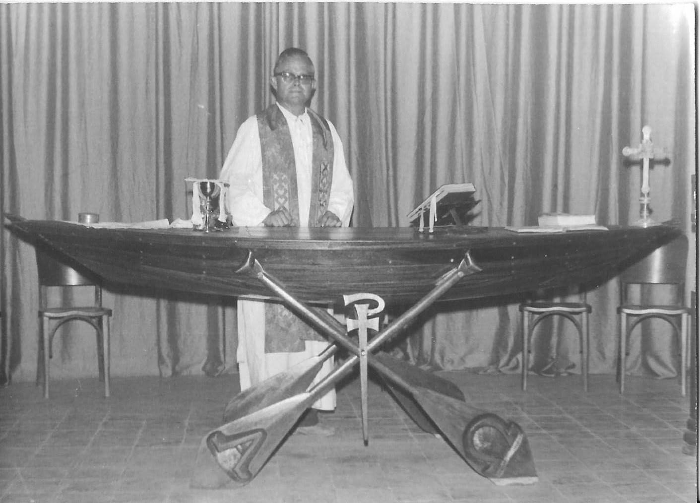 Redemptorist Father Vincent H. Aggeler stands at an altar made in the form of a canoe, in the parish church in Manacapuri, Brazil, in this undated photo. Pope St. John Paul II would offer Mass at this altar during one of his pastoral visits to Brazil.