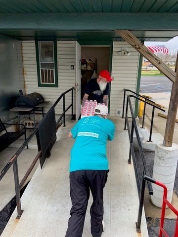 John Doyle, Parish Social Ministry Coordinator for Catholic Charities of Central and Northern Missouri, helps unload a shipment of food at the Eldon Senior Center in Eldon.
